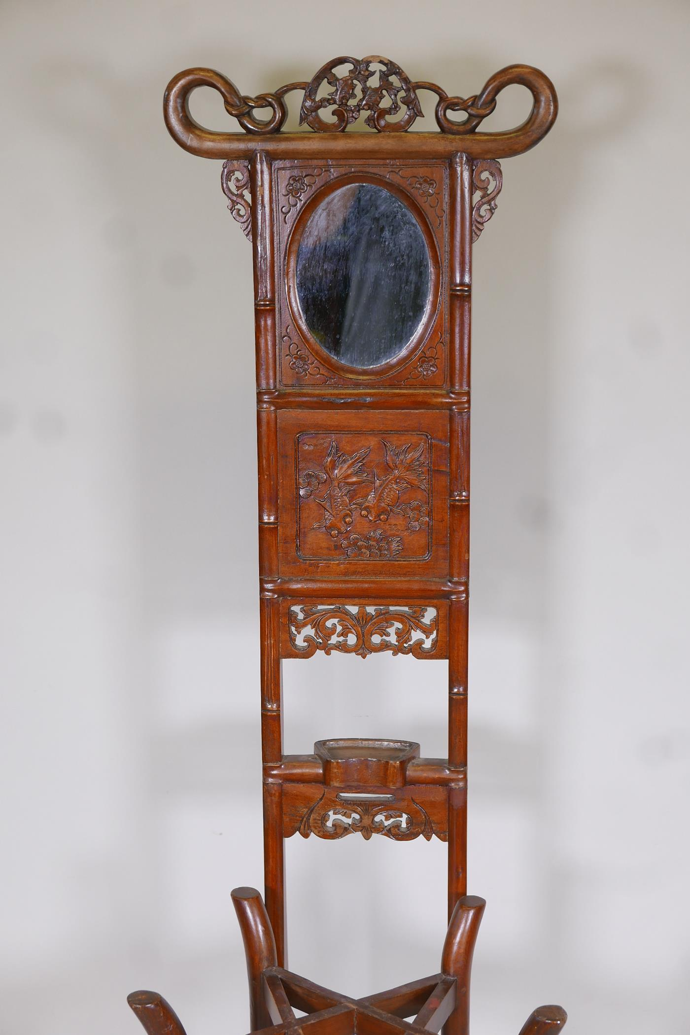 A Chinese hardwood wash stand with carved goldfish detail and inset mirror, the legs united by a - Image 2 of 4