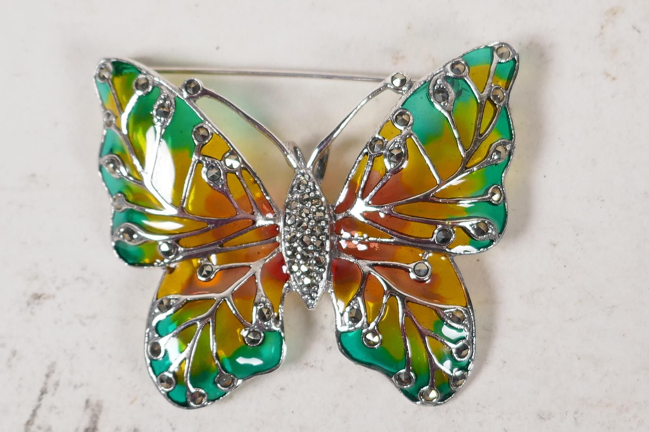 "A sterling silver and enamel butterfly brooch, 2"" wide"