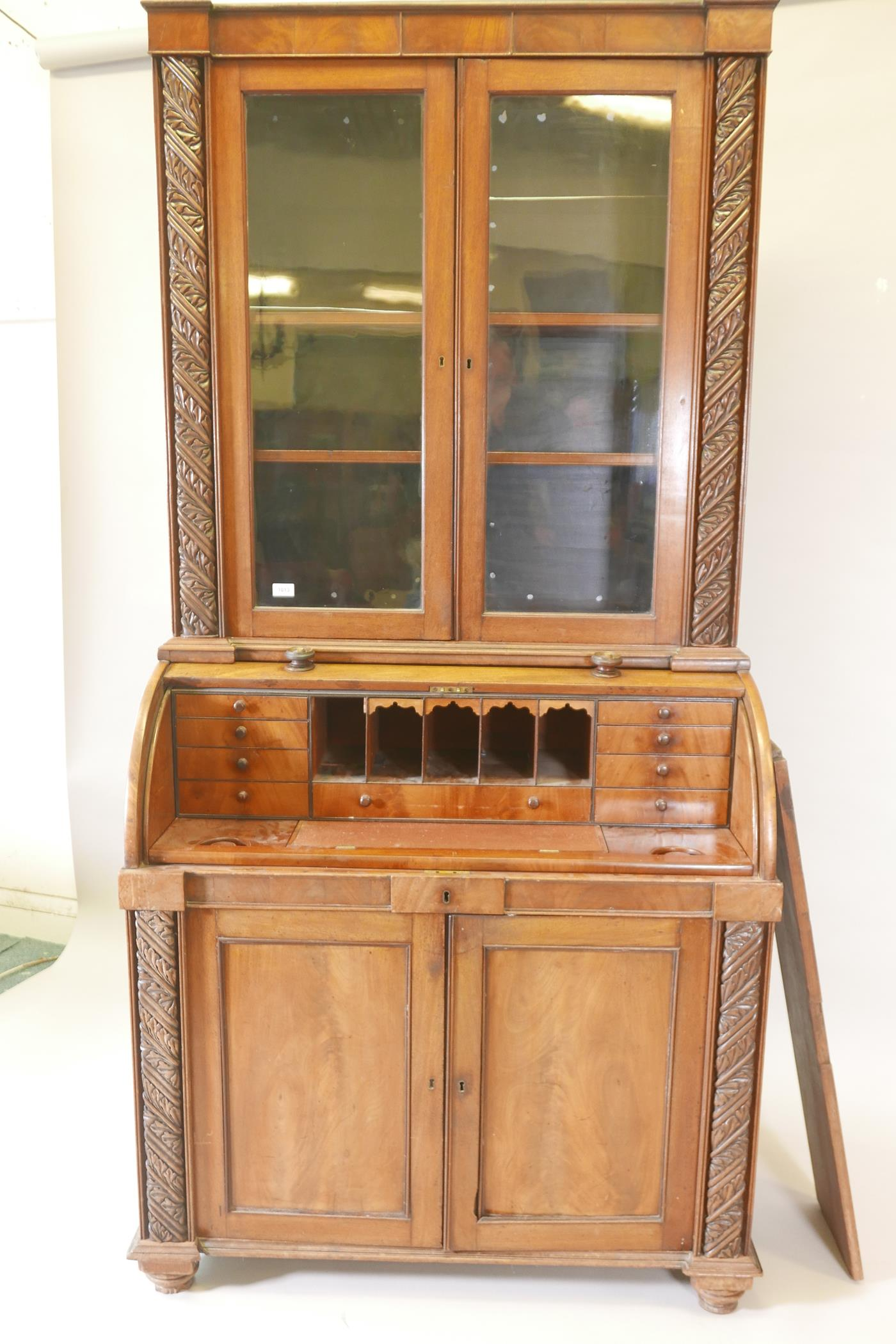 A Victorian cylinder top bureau bookcase, the upper section with two glazed doors and carved - Image 3 of 6