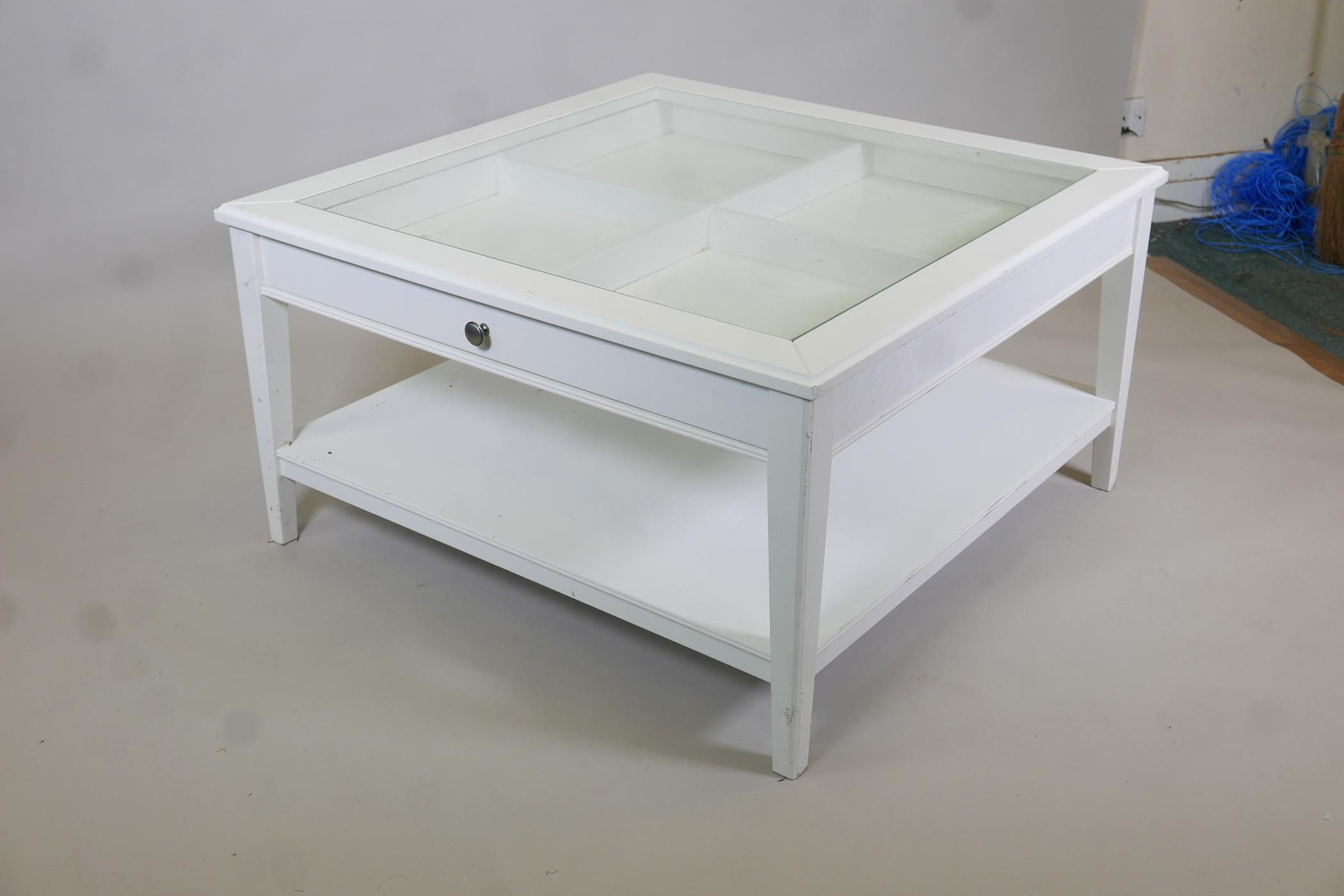 A painted coffee table with push-pull drawer and glass top, raised on tapering supports united by an - Image 2 of 3