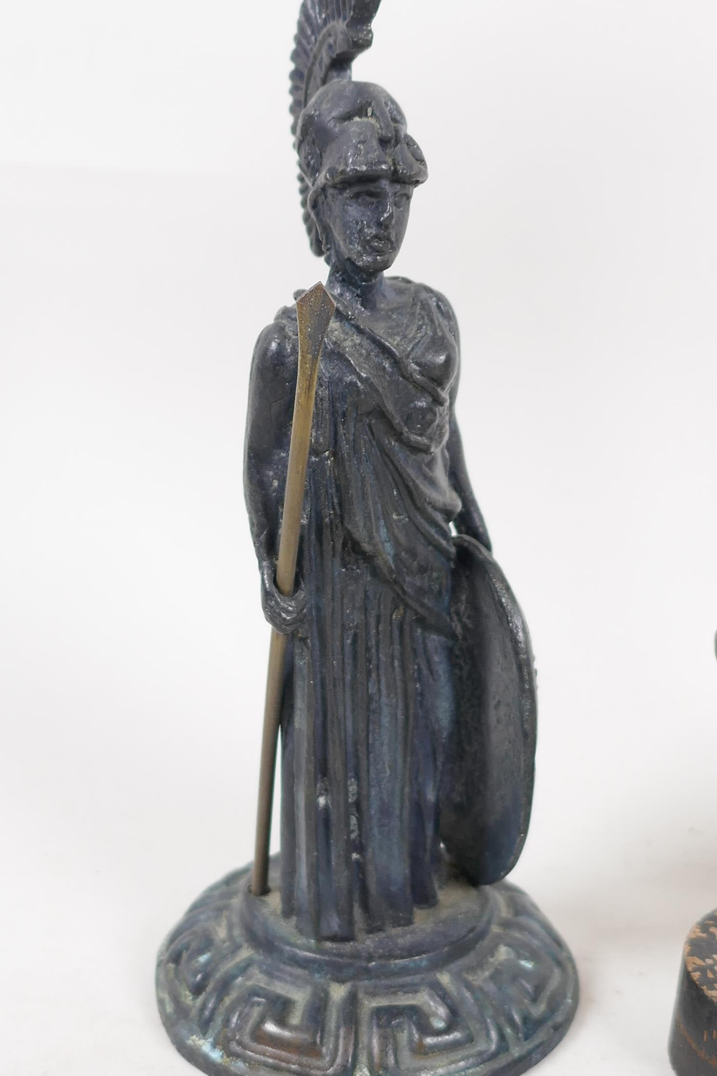 """A small bronze figure of a Roman soldier after the classic, 6"""" high, a brass figural candlestick and - Image 4 of 4"""
