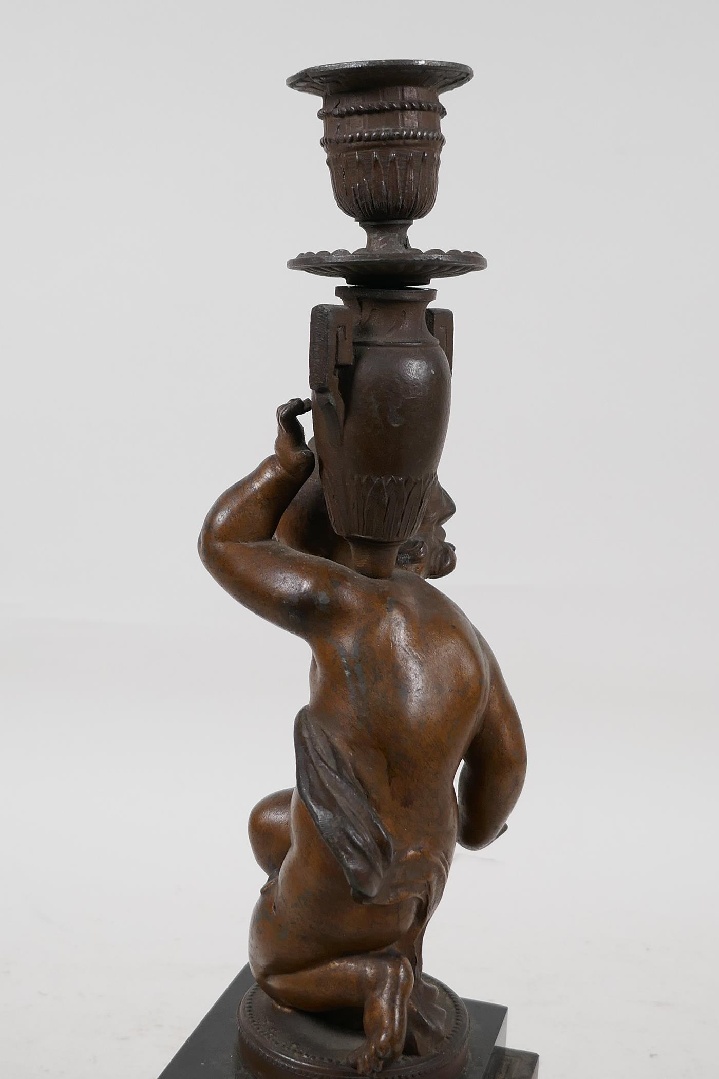 """A C19th bronze candlestick cast as a cherub, raised on stepped marble base, 13"""" high - Image 5 of 6"""