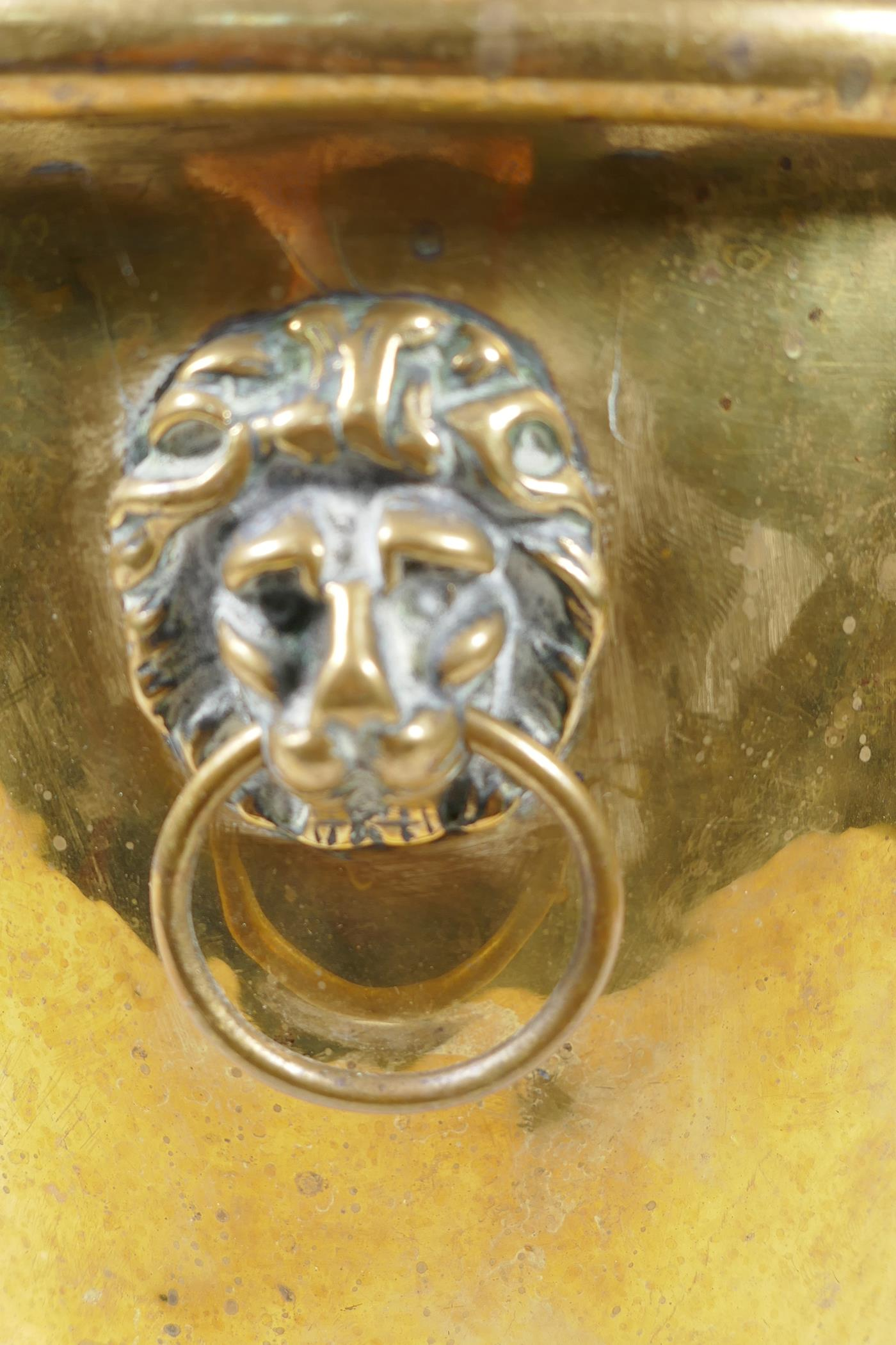 """A C19th polished brass jardiniere with lion mask handles and three paw feet, 9"""" high - Image 3 of 4"""