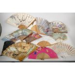 A collection of twelve painted paper fans, Spanish and oriental, and a bone and silk fan, mainly