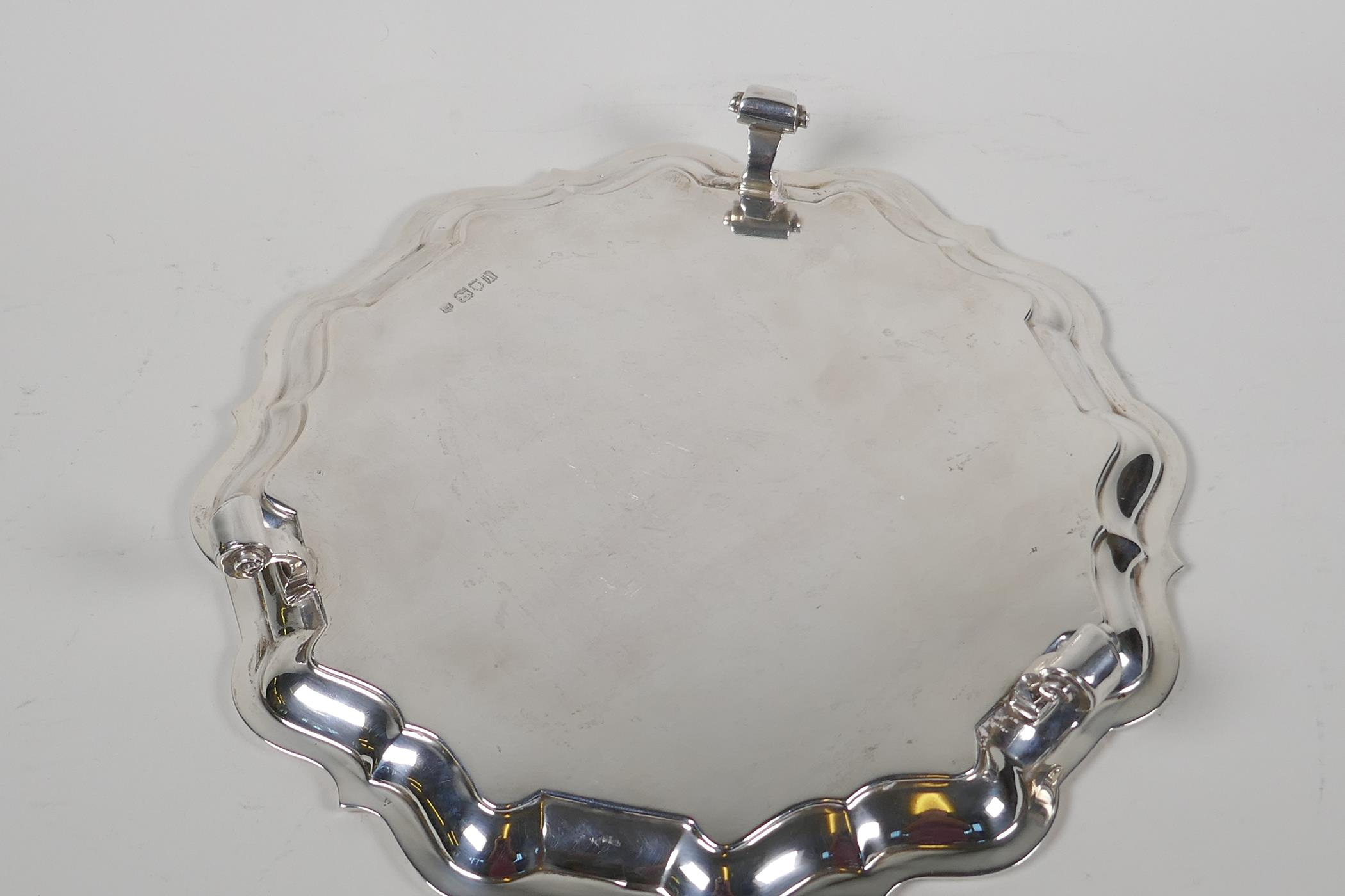 A hallmarked silver serving tray with gadrooned rim, on three cast scroll supports, hallmarked - Image 4 of 5