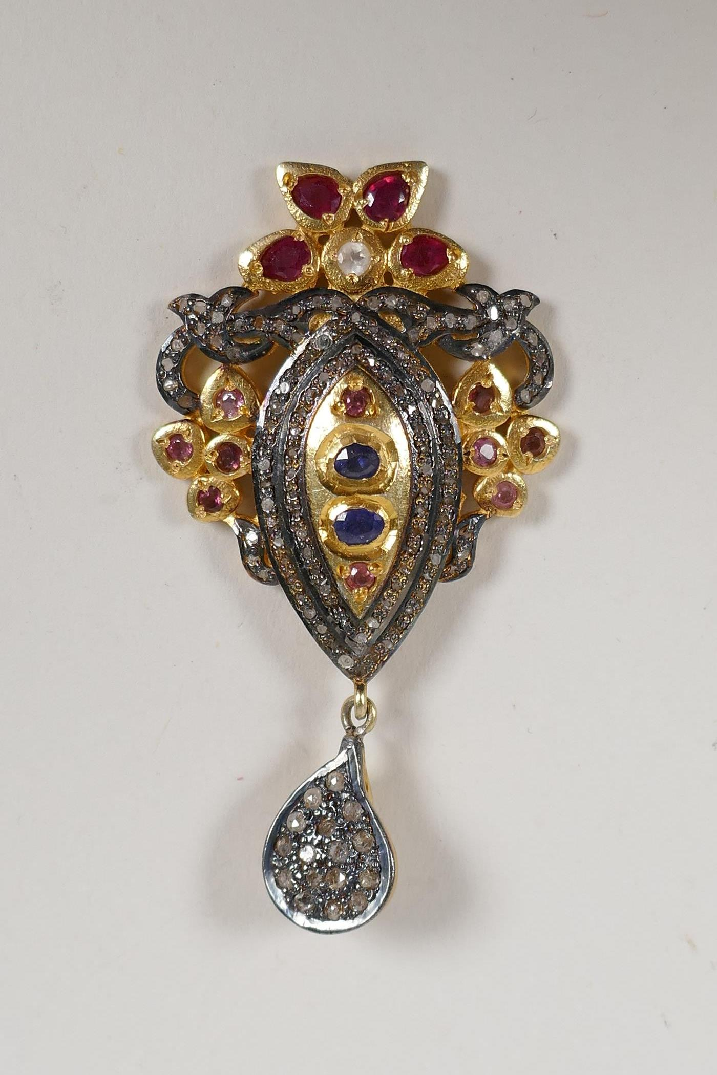 """A silver gilt pendant set with uncut diamonds, rubies and sapphire, en suite to previous lot, 2"""" - Image 2 of 2"""