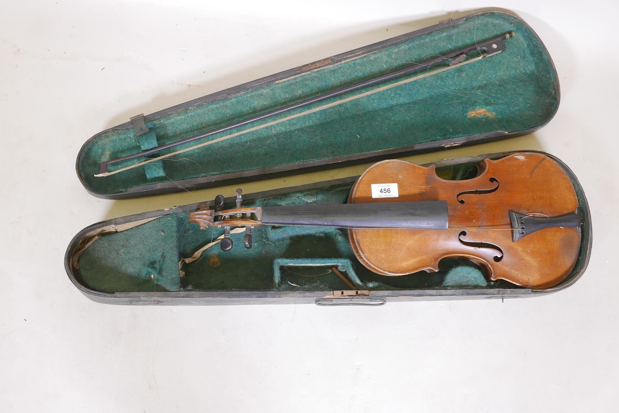 """An antique violin and bow in case, bears label Andreas Amati fecit, Cremonae anno 1604, back 14½"""""""
