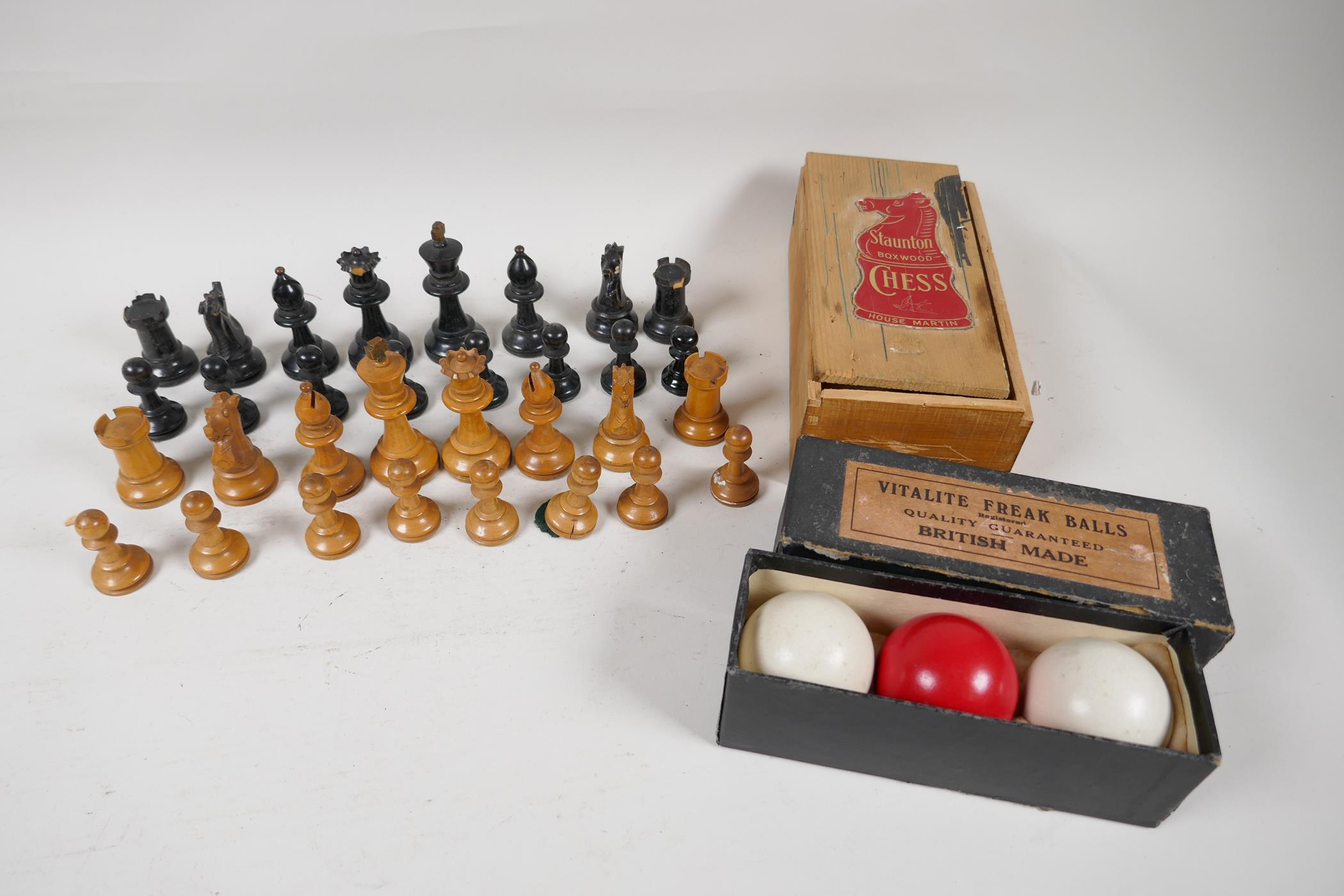 "A Stanton boxwood chess set, kings 2¾"" high, and a set of three Vitalite Freak billiard balls"
