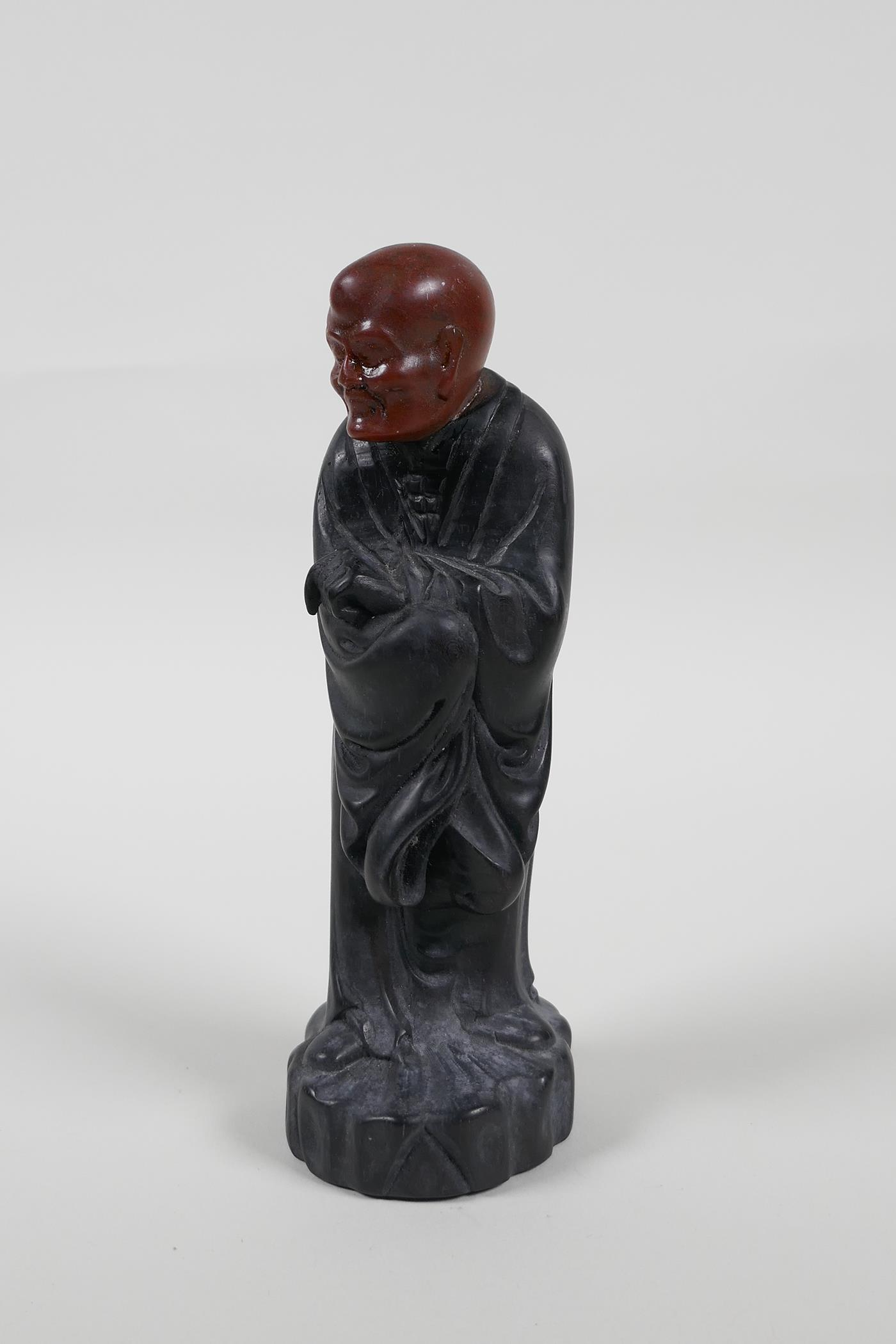 """A Chinese carved Zitan wood figure of Lohan with soapstone head, 6"""" high"""