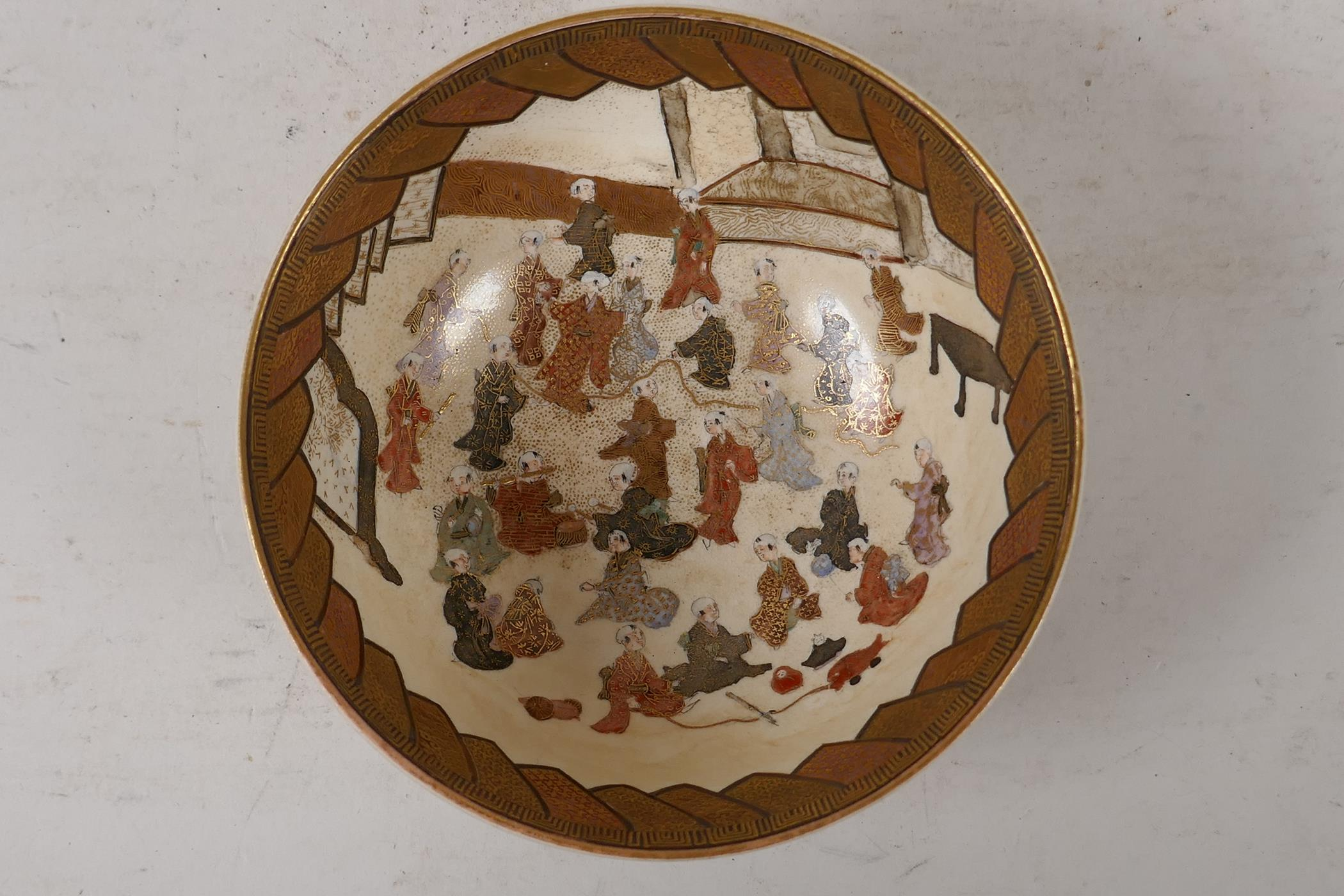 A Japanese meiji period satsuma bowl, decorated with children to the interior, the exterior with