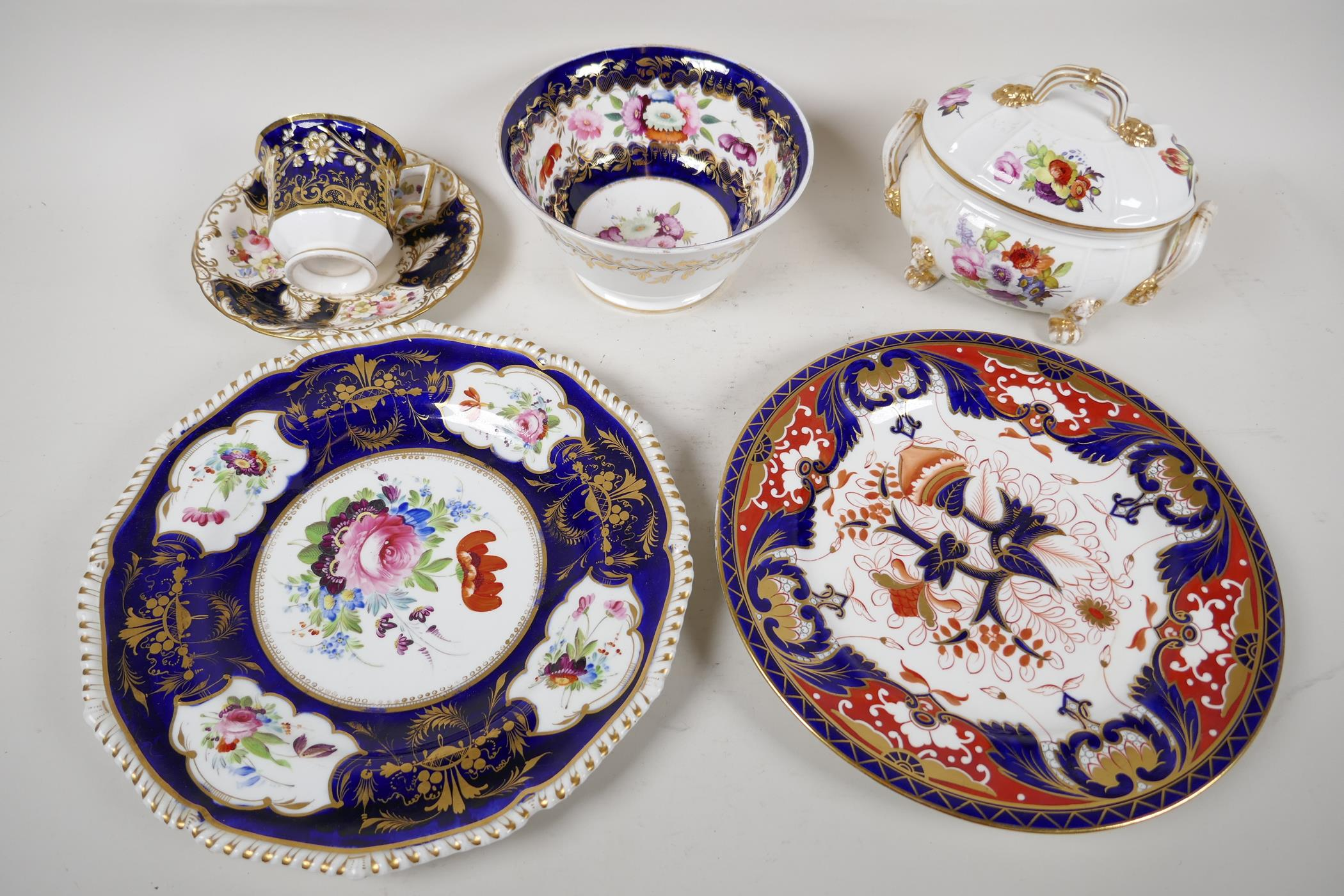 """A Crown Derby sauce tureen and cover, with hand painted flowers and gilt highlights, 6½"""" wide, and"""