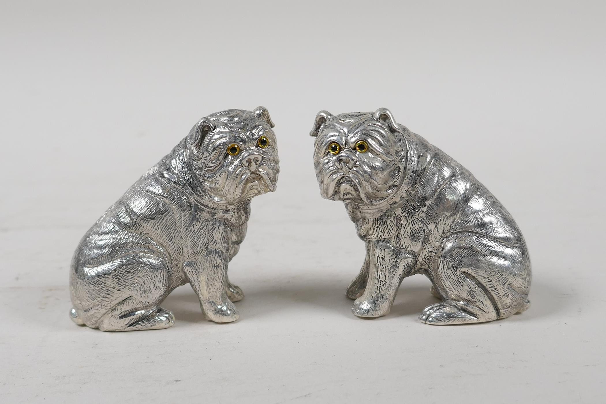 """A pair of silver plated condiments in the form of bulldogs, marked 800 to base, 2½"""" high"""