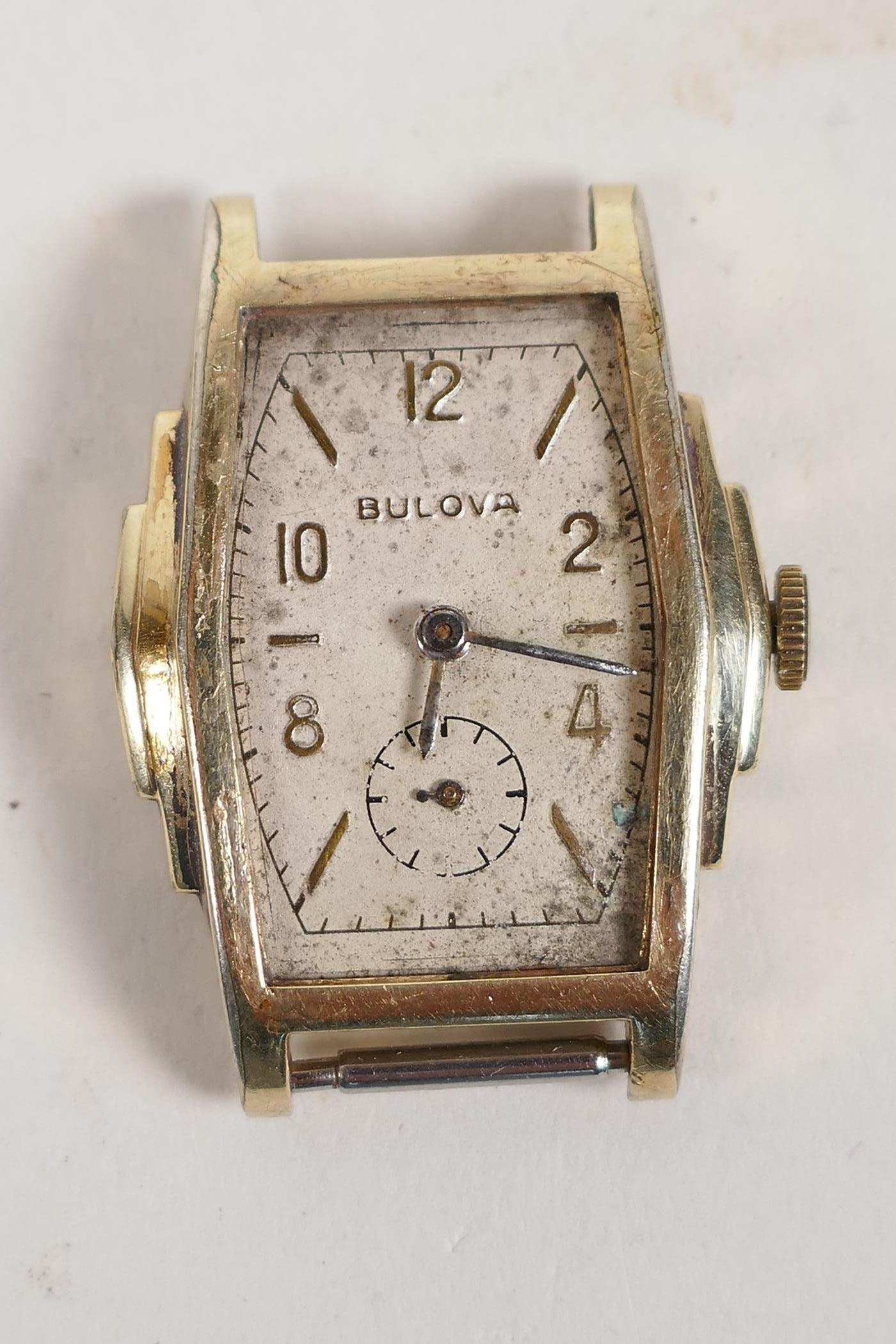 A vintage gilt plated Bulova wrist watch with a small subsidiary second hand dial, lacks strap, A/F,