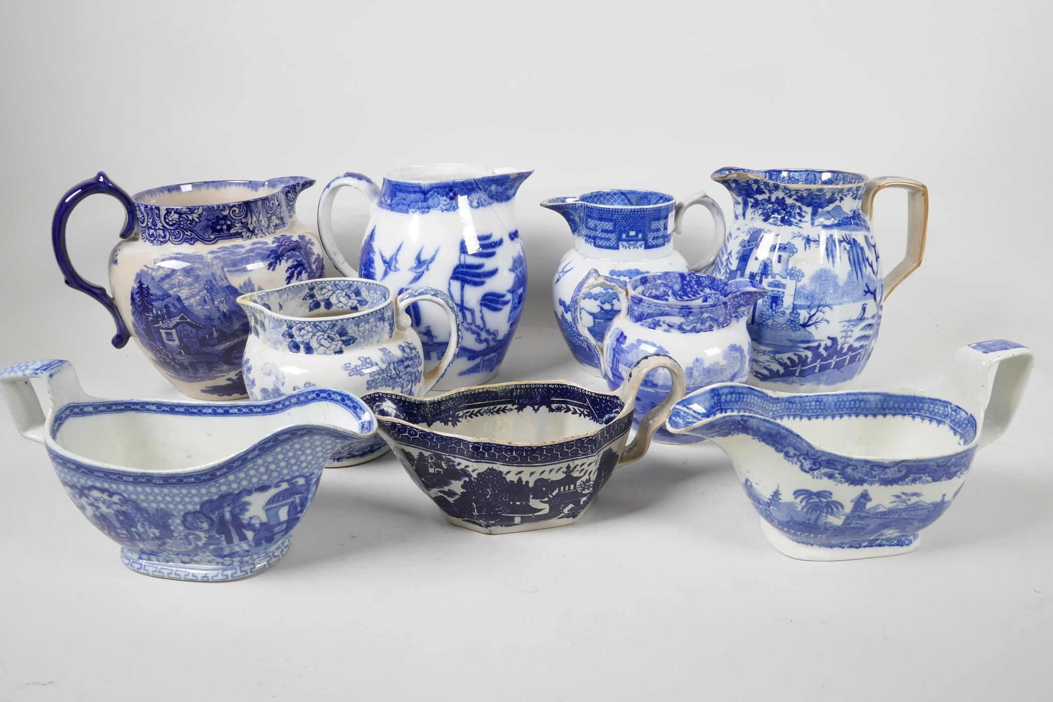 """Six blue and white transfer printed jugs and three gravy boats, various patterns, largest 6"""" high"""