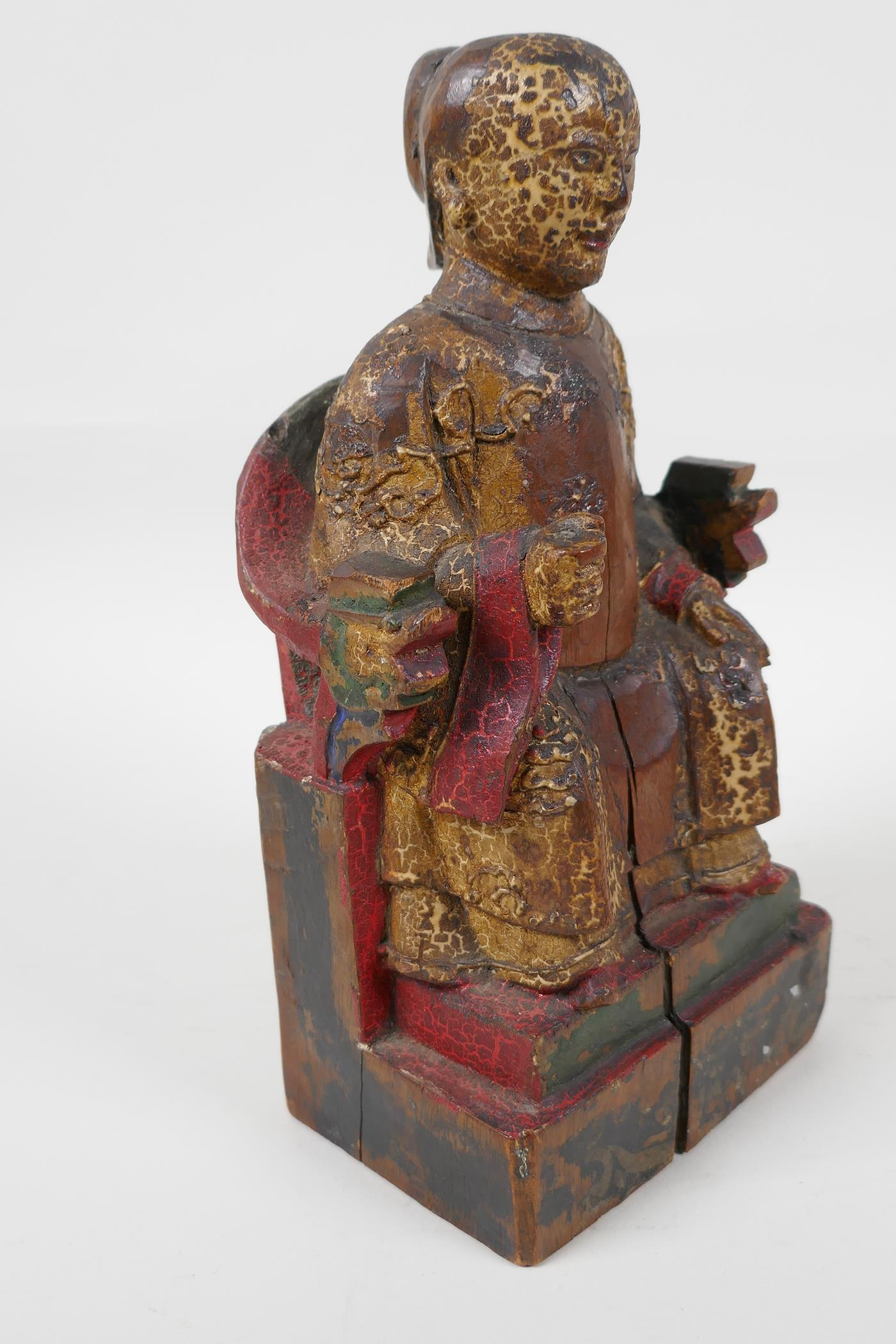 """A Chinese carved wood figure of a dignitary seated on a throne, traces of paint, 9"""" high - Image 2 of 6"""