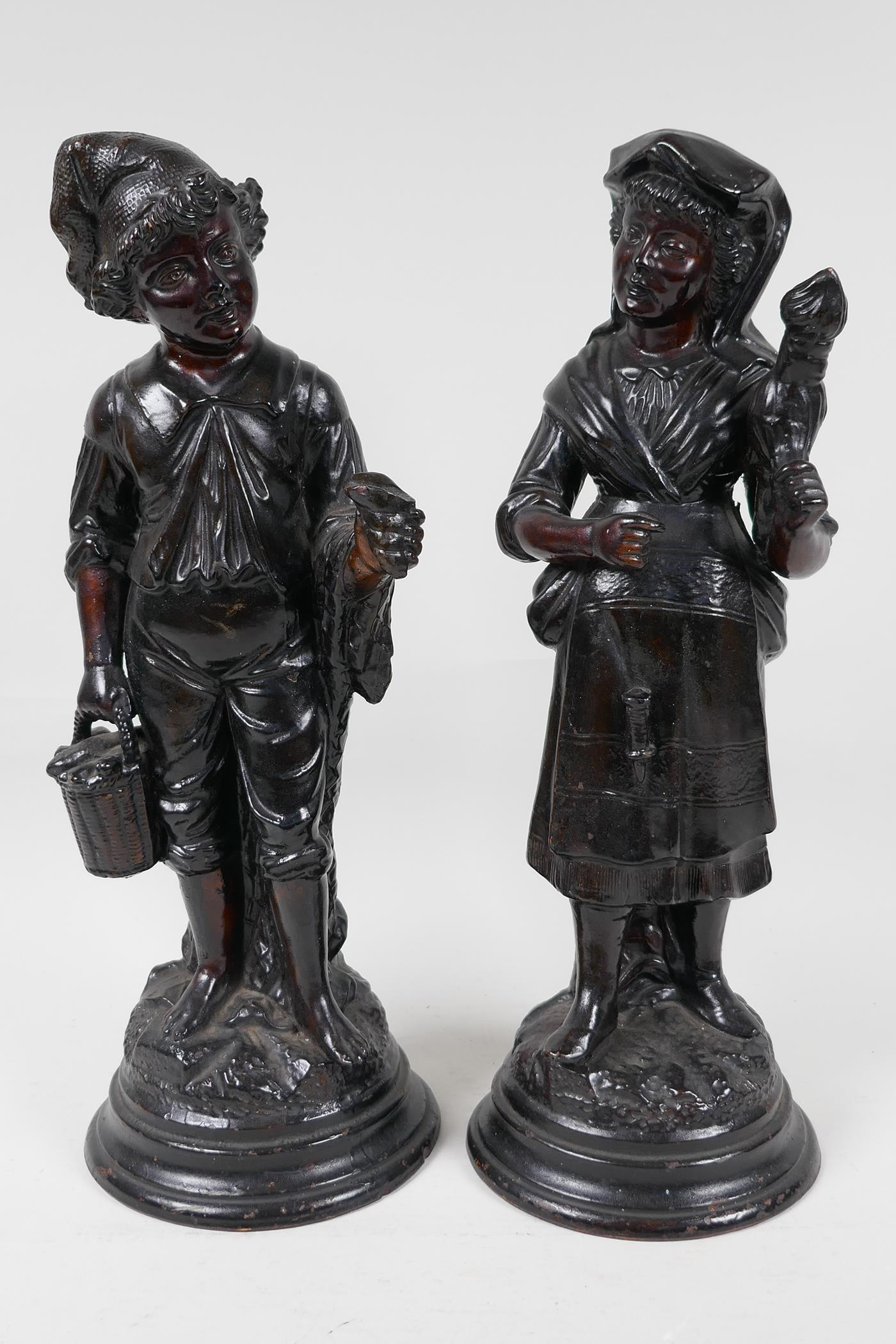 """A pair of French C19th brown glazed earthenware figures, marked HB (Quimper) G75, 13"""" high"""
