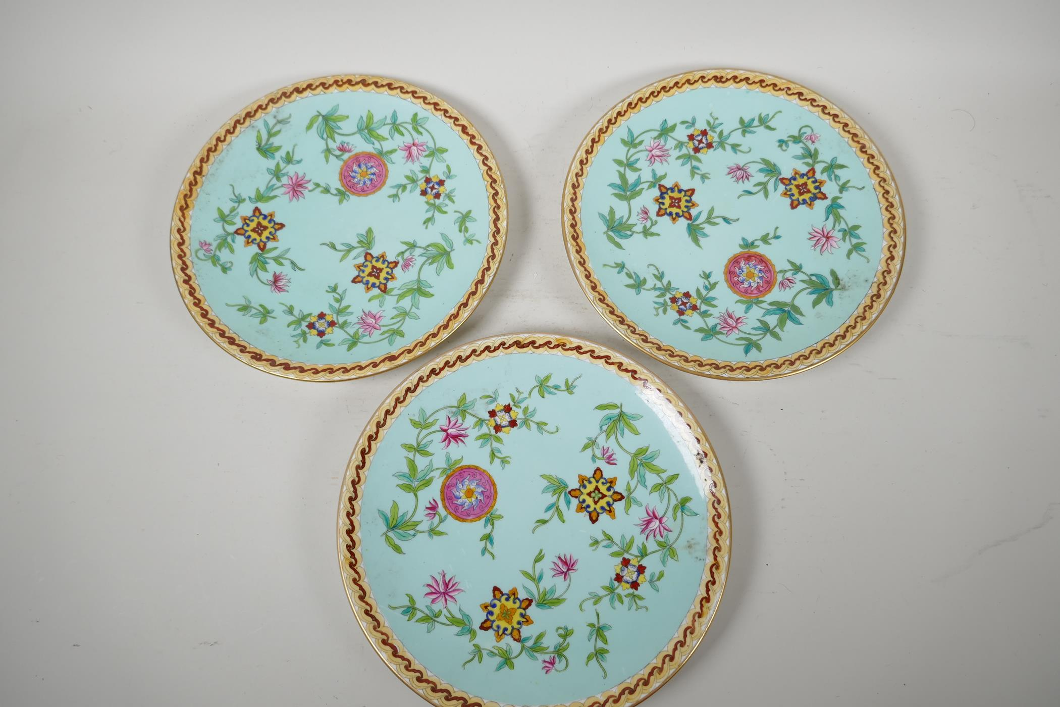 """Three continental porcelain plates decorated in the Oriental manner, 9½"""" diameter"""