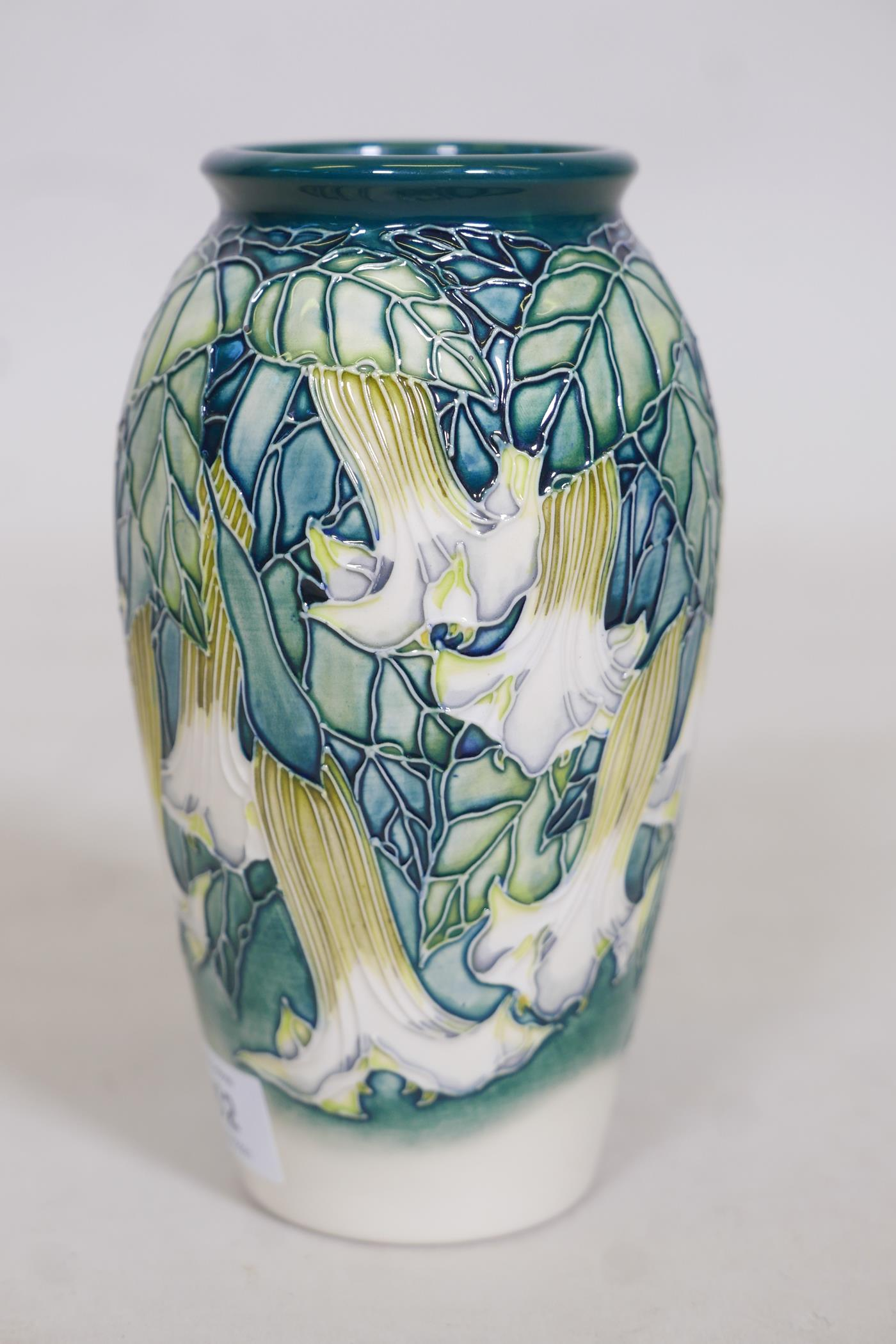 A Moorcroft vase 'Angels Trumpet' by Anji Davenport, stamped to base, 98, Moorcroft Collectors Clubs