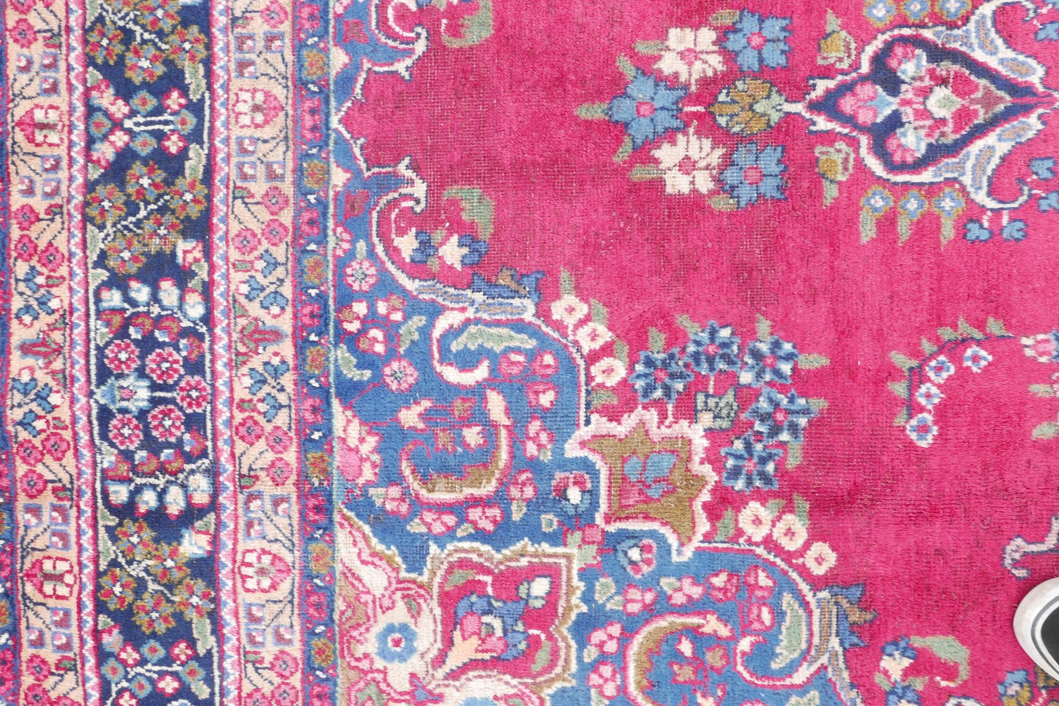 """A pink/red ground Persian Kashmar carpet with a floral medallion design, 77"""" x 117"""" - Image 2 of 7"""