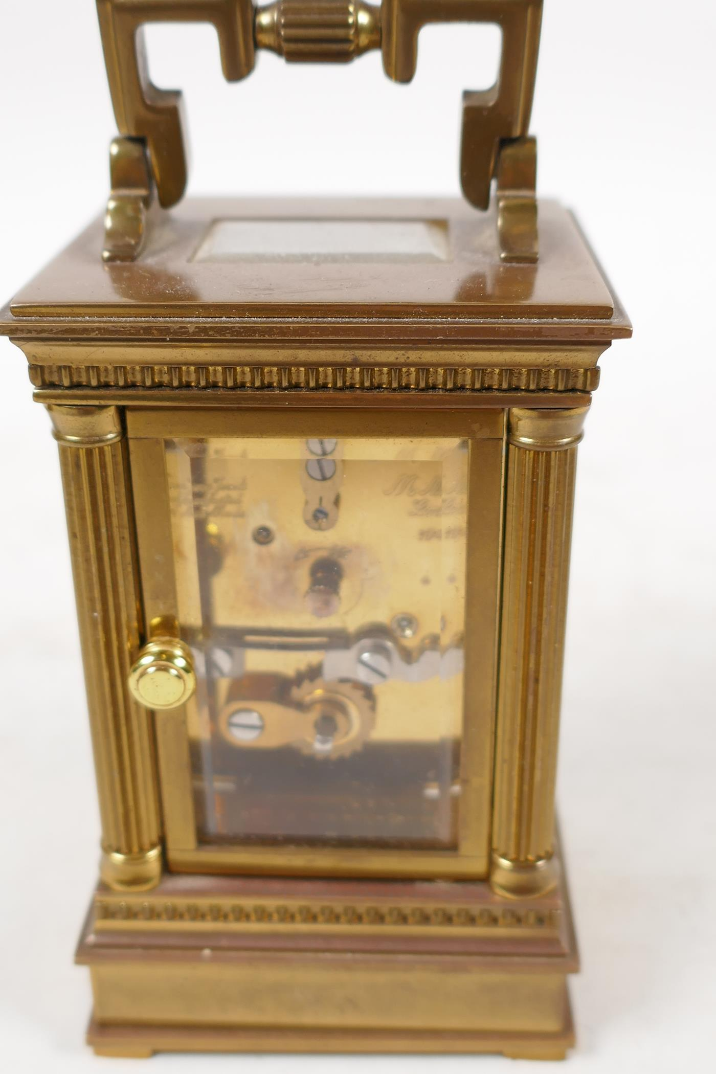 A Swiss made carriage clock in brass case with reeded columns, white enamel dial and Roman numerals, - Image 3 of 4