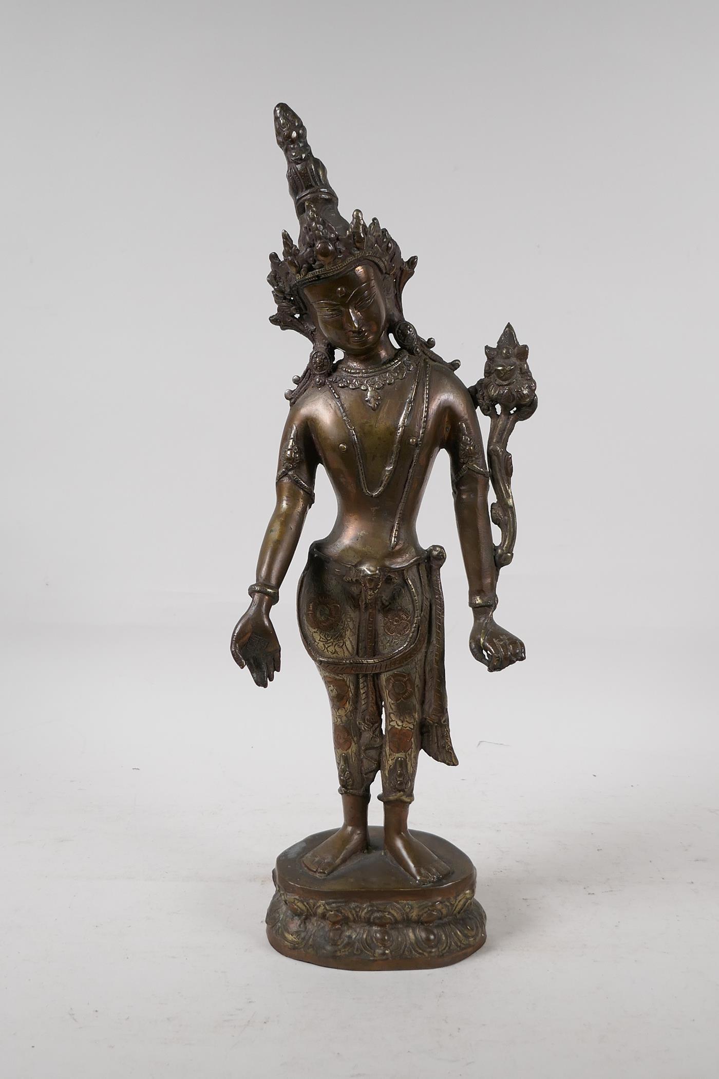 "An Indian bronze deity on a lotus throne, 17"" high"