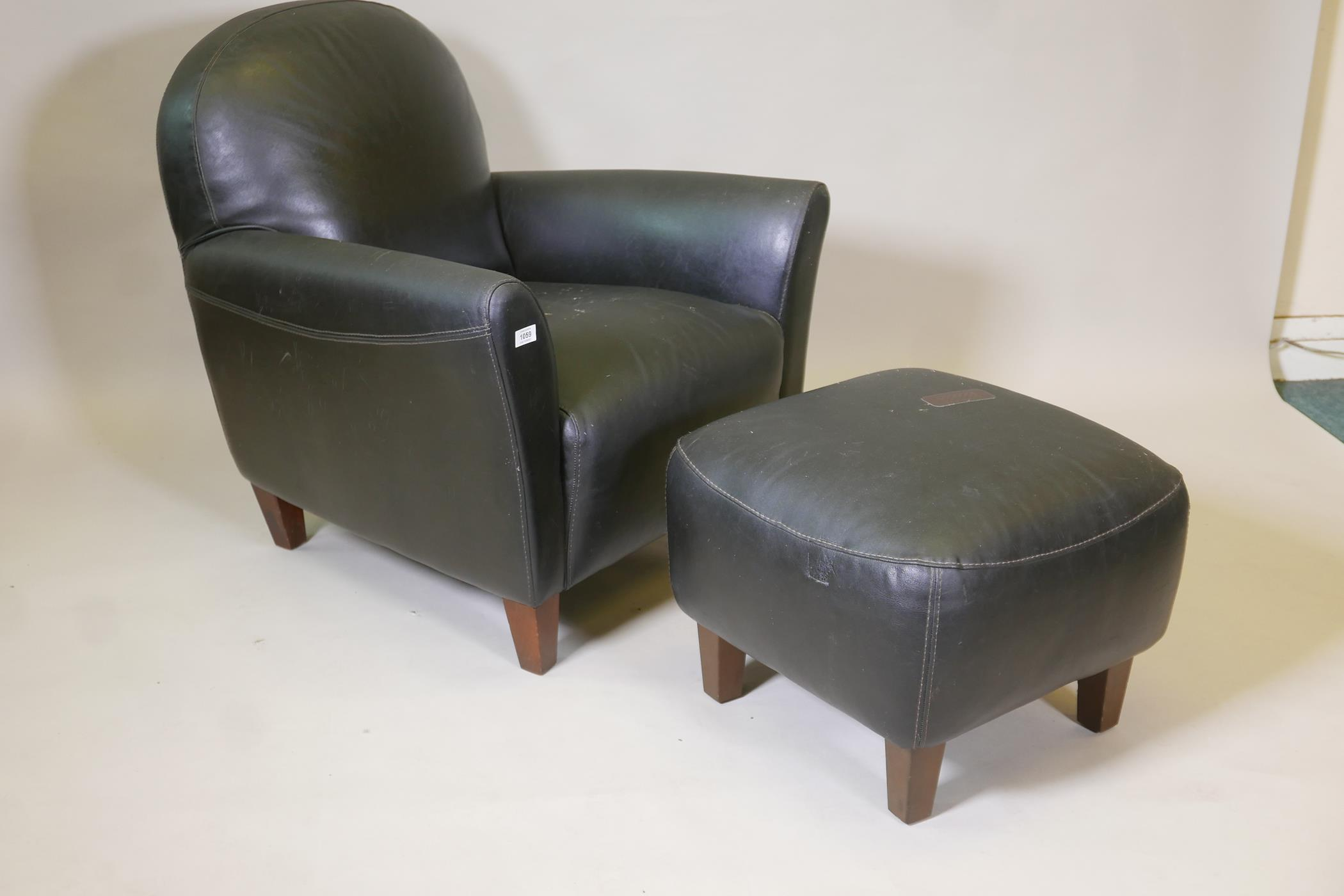 An Italian 'Calia' black leather club chair and matching foot stool