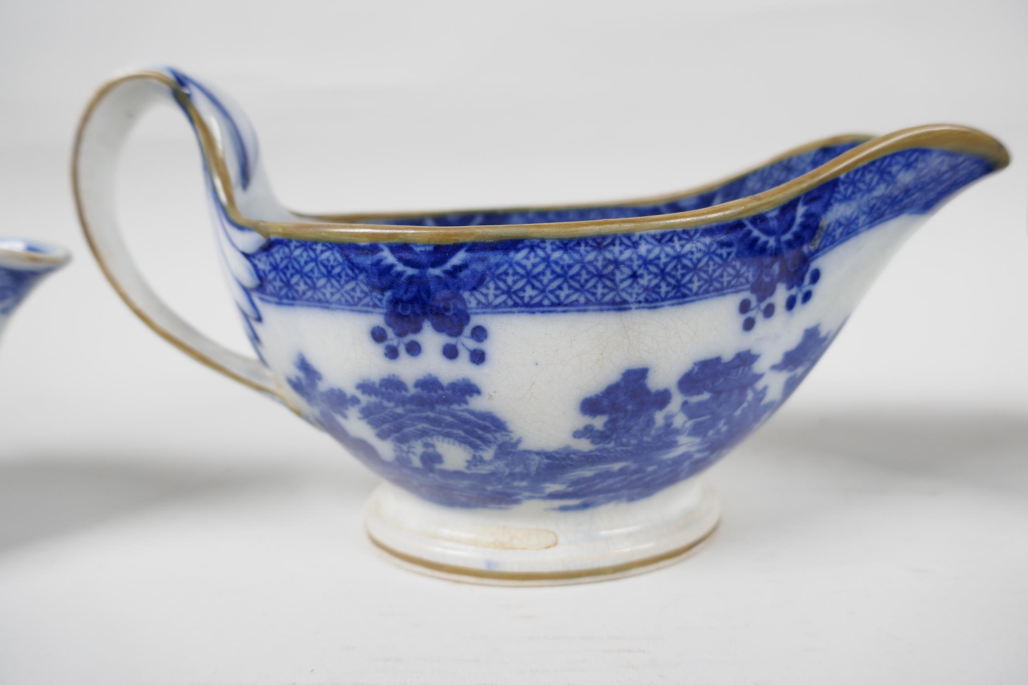 Five late C18th/early C19th English blue and white pottery sauce boats to include Boy on a Buffalo - Image 5 of 9