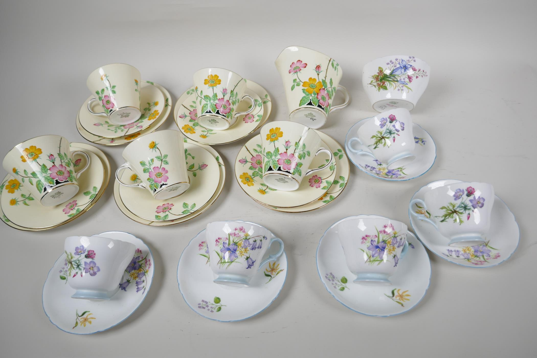 A five place setting Aynsley china tea set with milk jug, together with a five place setting Shelley