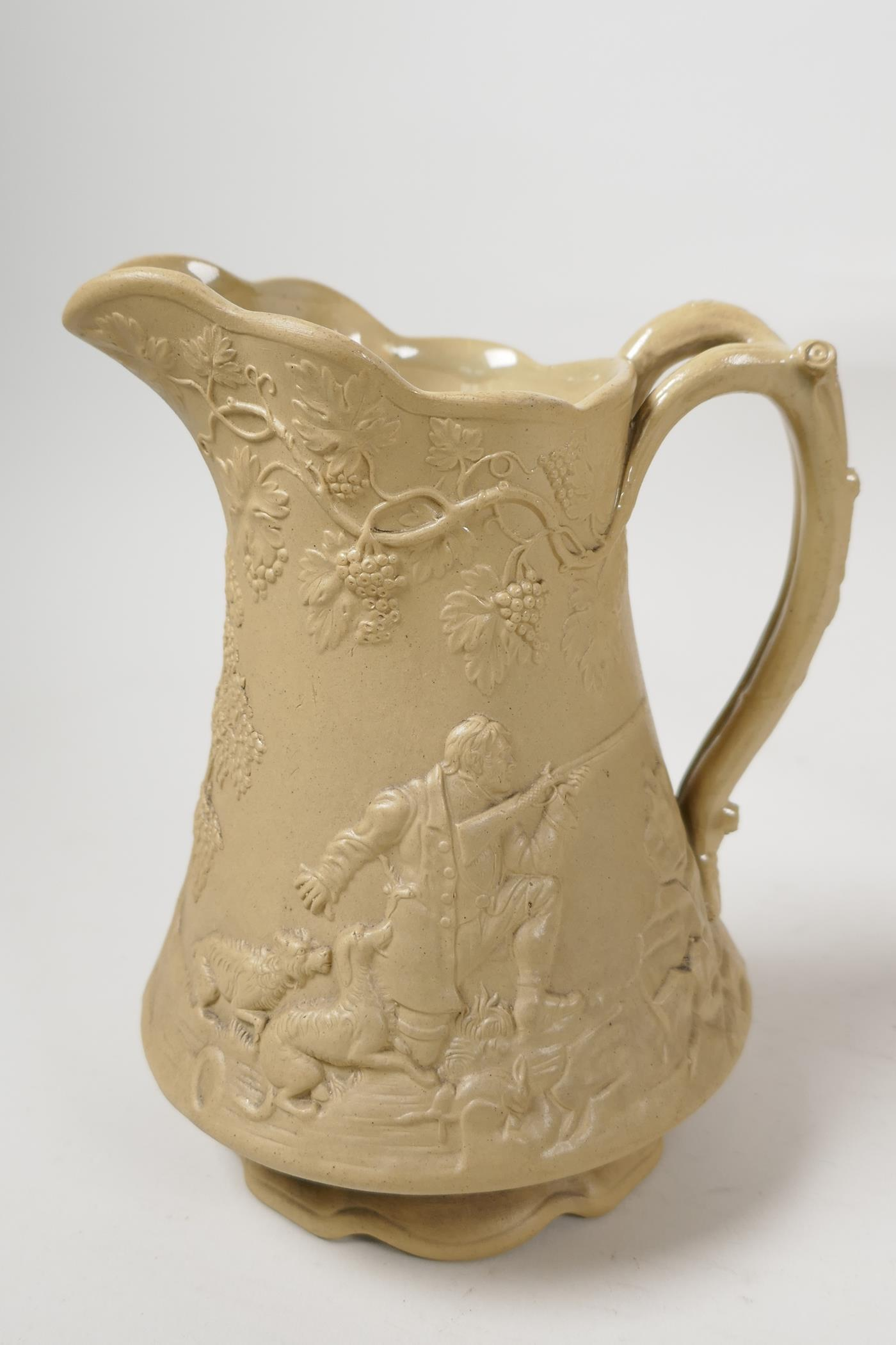 """A C19th pottery jug embossed with hunting figures and fruiting grape vine, lozenge mark to base, 5½"""" - Image 3 of 8"""