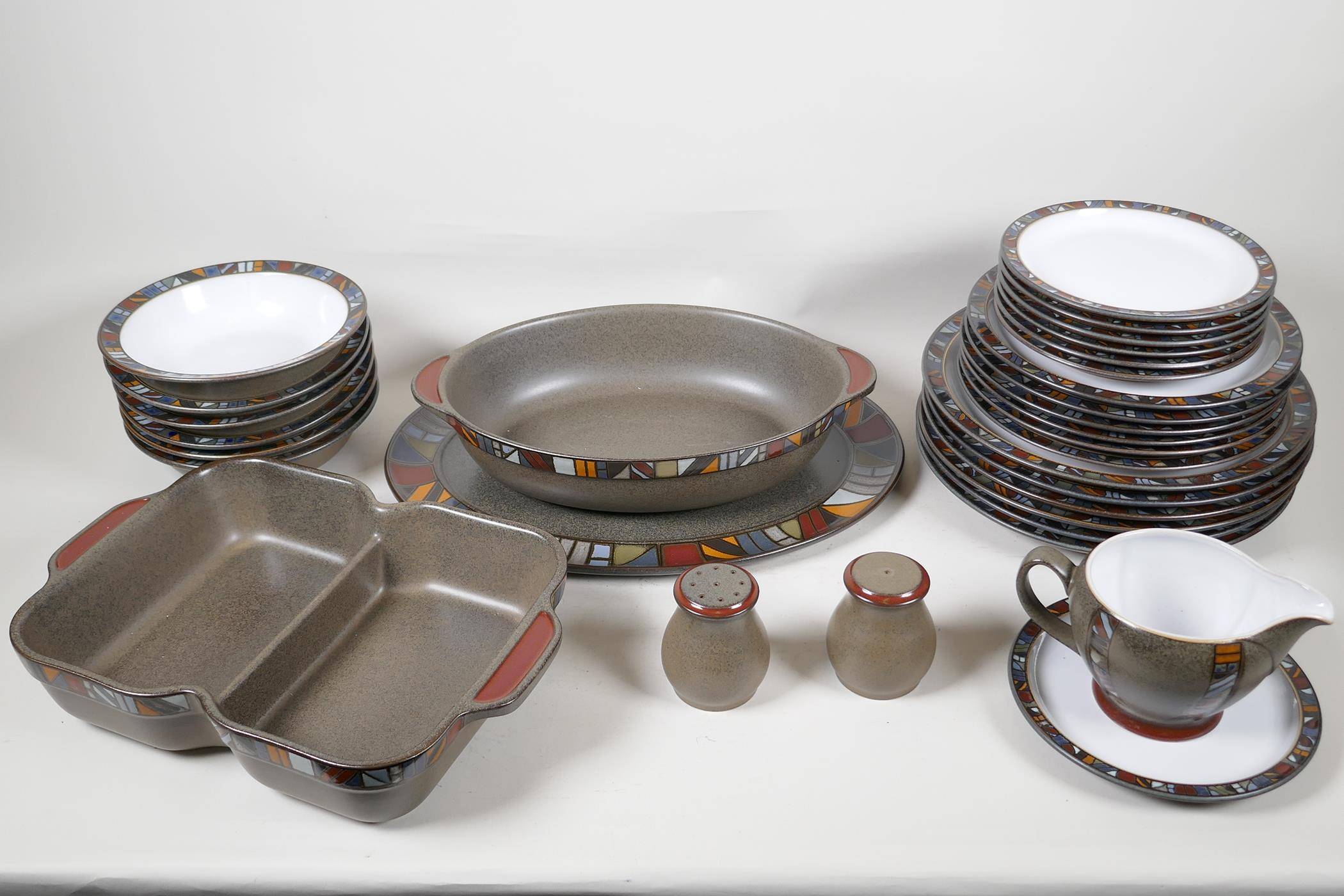 A Denby 'Marrakesh' six setting dinner service, with a pair of condiments, gravy jug, vegetable