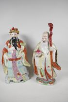 """A Chinese porcelain figure of a dignitary with a bejewelled ruyi, painted in bright enamels, 15"""""""