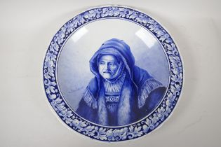 """A Delft blue and white wall plaque painted with a portrait after Rembrandt, 15"""" high"""