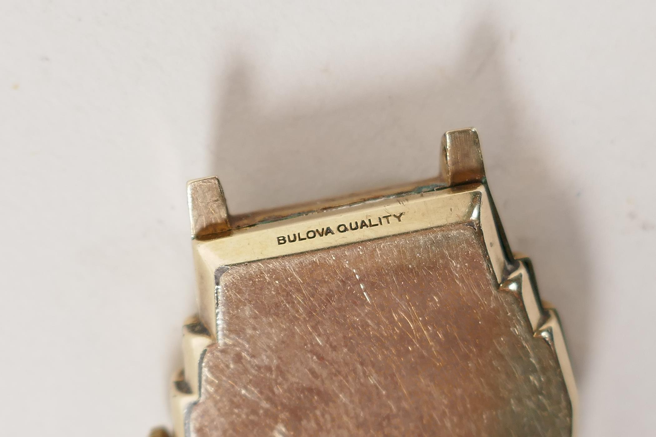 A vintage gilt plated Bulova wrist watch with a small subsidiary second hand dial, lacks strap, A/F, - Image 2 of 3