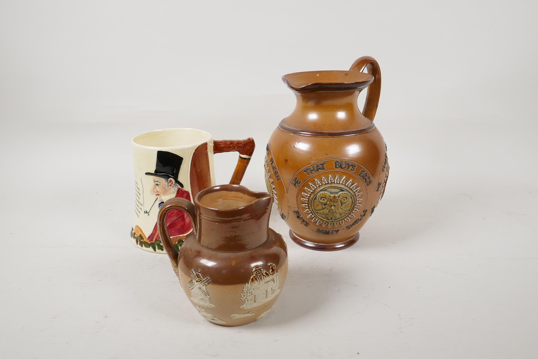 A Doulton Lambeth stoneware jug bearing the legend 'He that buys good ale' embossed with various