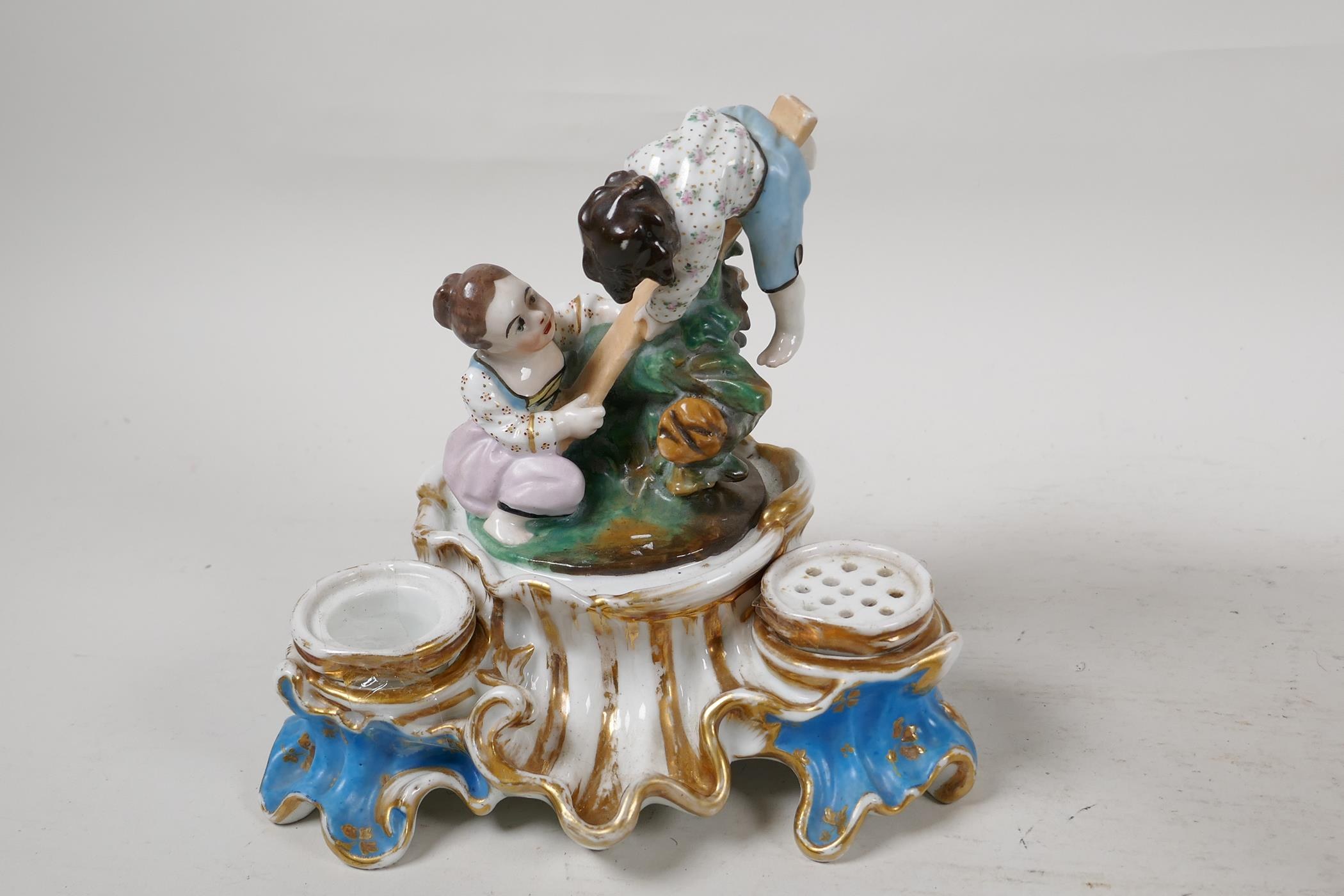 """A C19th continental porcelain inkwell modelled as two children on a seesaw, 6"""" high, and a - Image 6 of 6"""