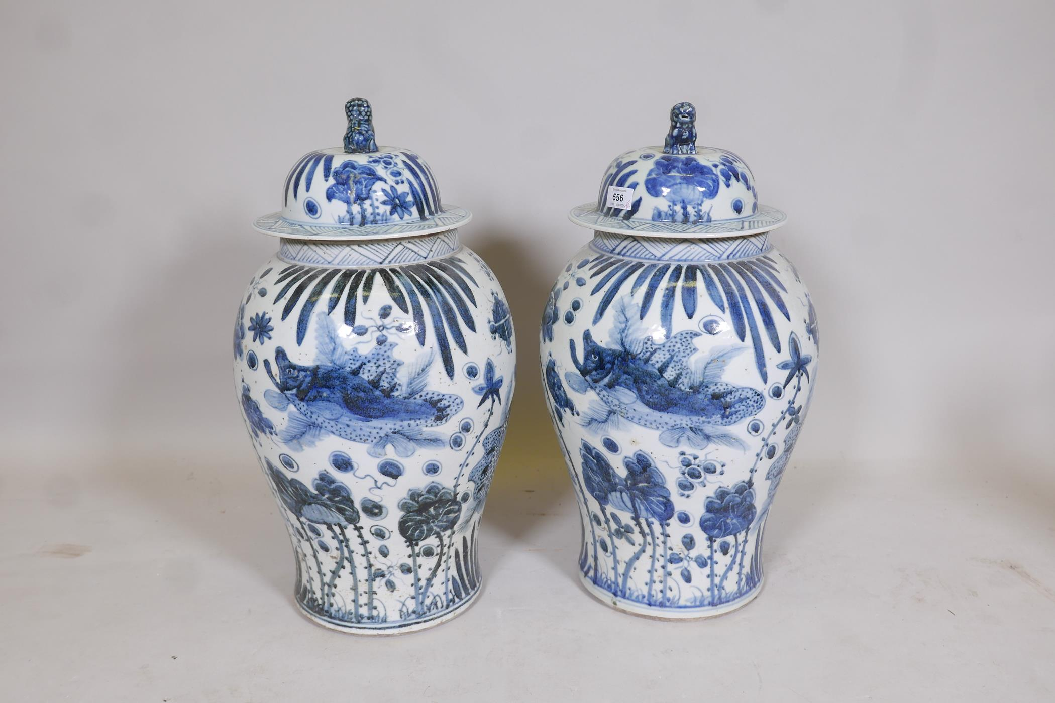 A pair of Chinese blue and white porcelain meiping jar and covers decorated with carp in a lotus - Image 4 of 5
