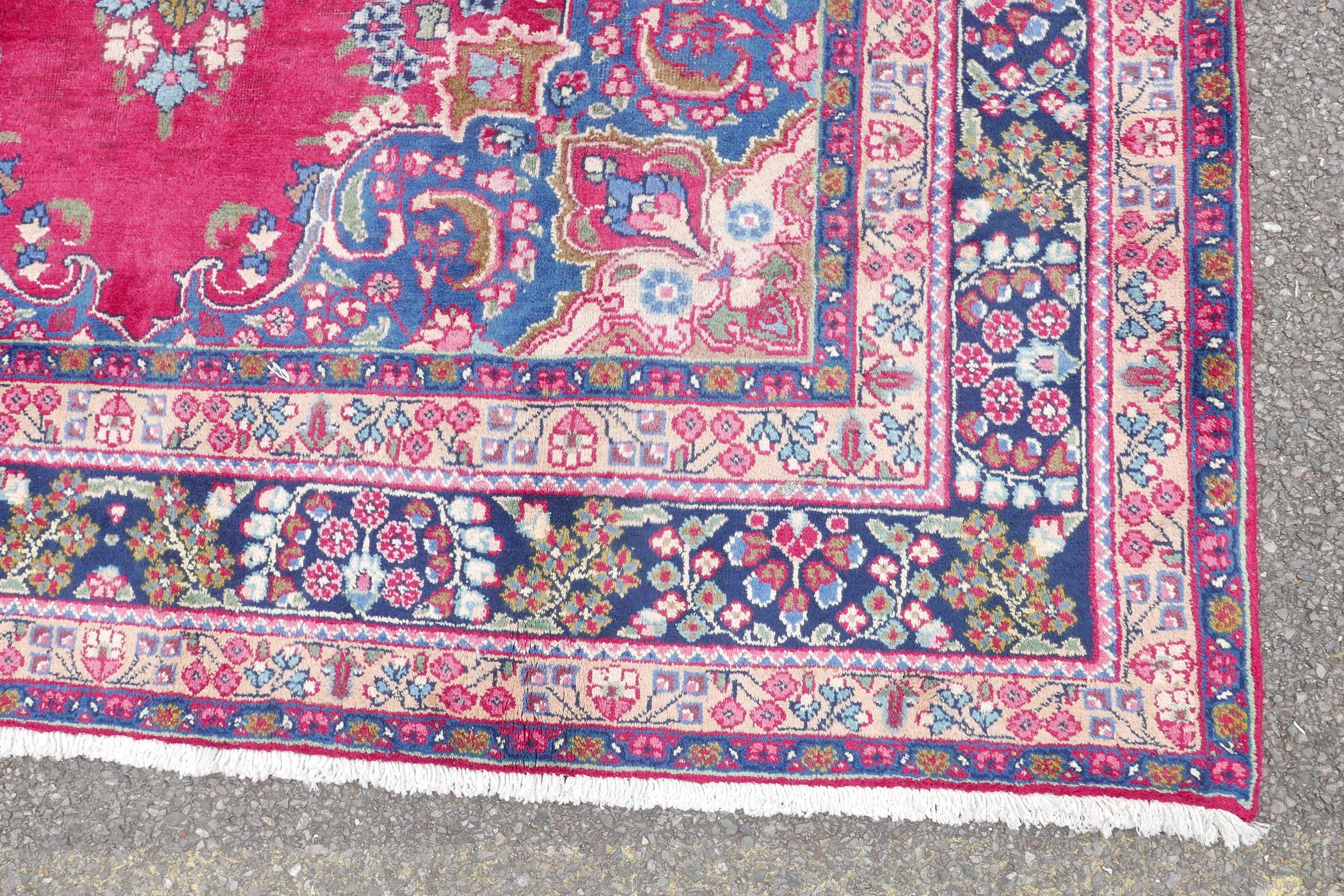 """A pink/red ground Persian Kashmar carpet with a floral medallion design, 77"""" x 117"""" - Image 6 of 7"""