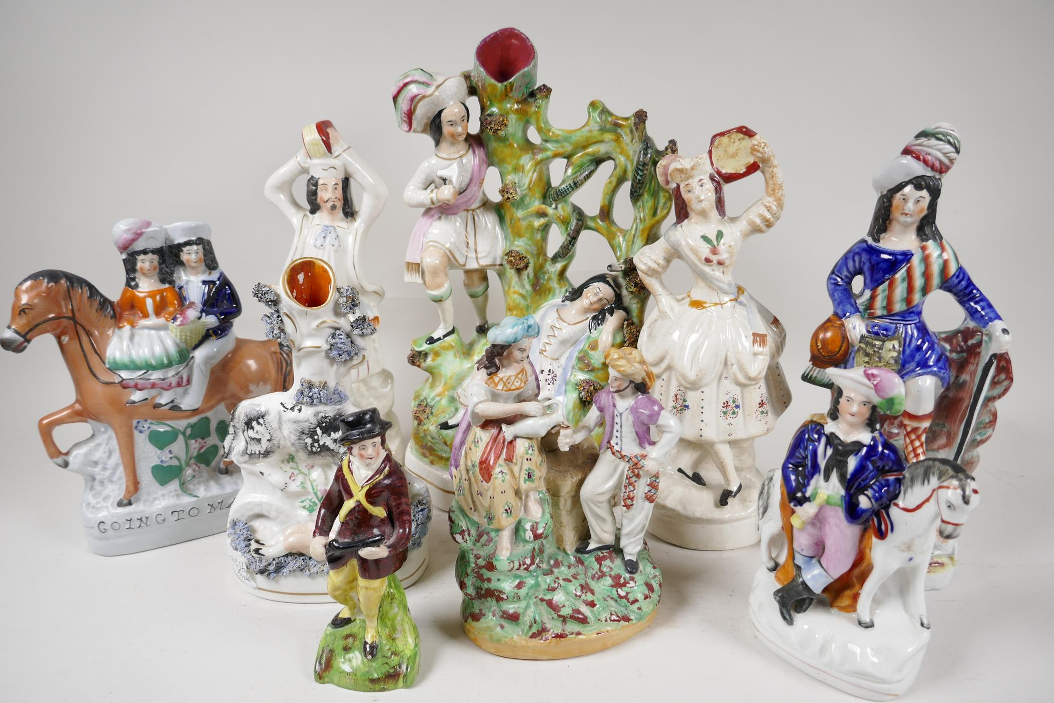 Nine early Staffordshire figures, the largest of a lady sleeping by a tree, a snake and her saviour,