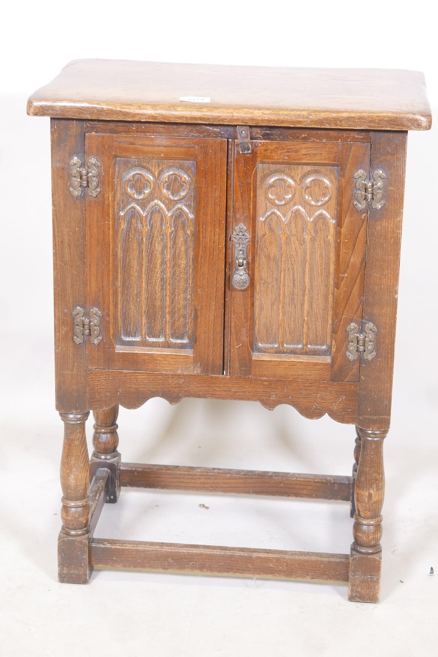 """An oak two door cabinet with Gothic style carving, 20"""" x 13"""" x 27"""""""