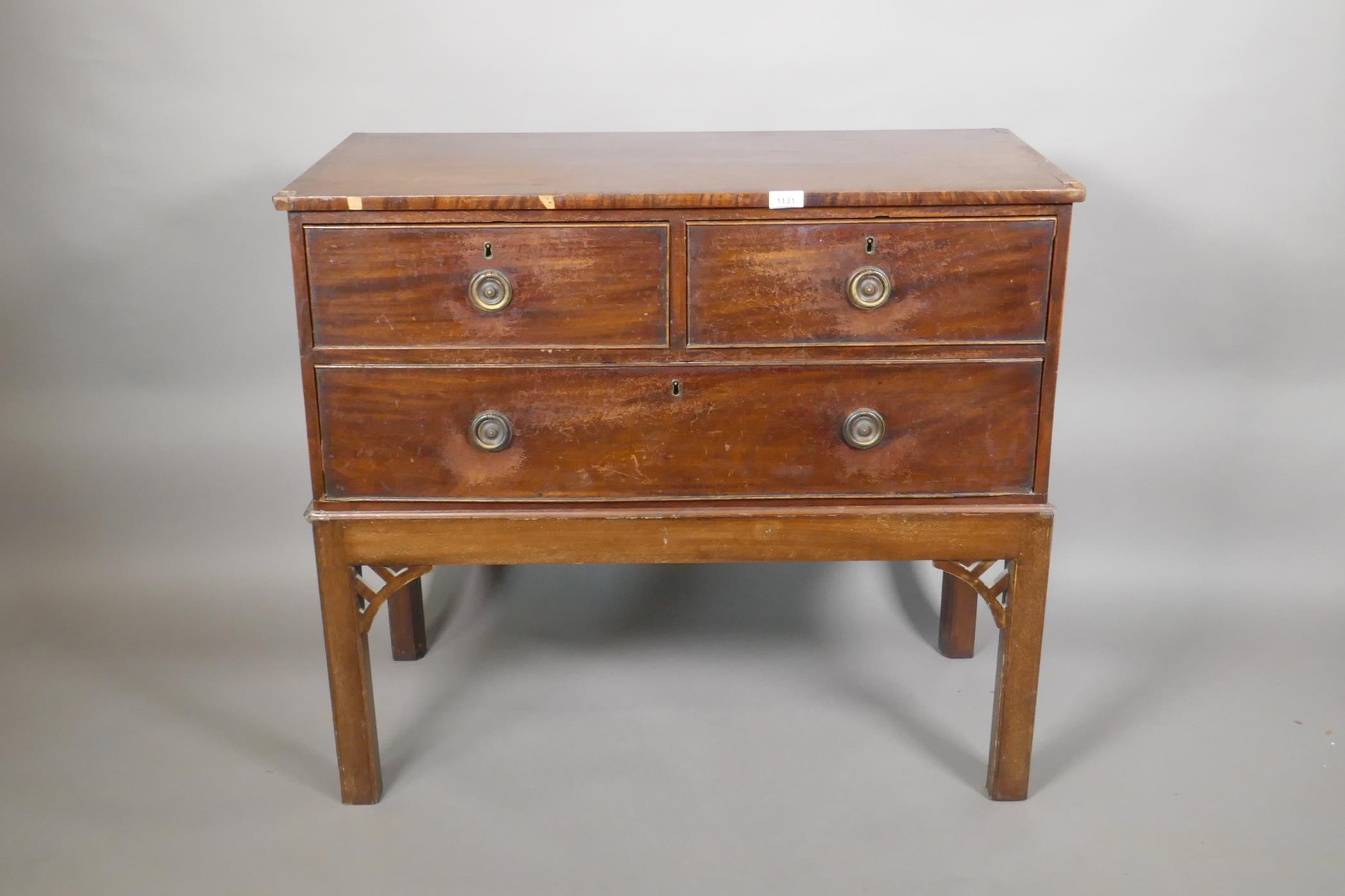 """A mahogany three drawer chest of drawers on an adapted stand, 32"""" high, 37"""" wide, 18"""" deep"""