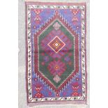 """A multi colour ground full pile Belouch nomadic rug with unique medallion design, 36"""" x 60"""""""