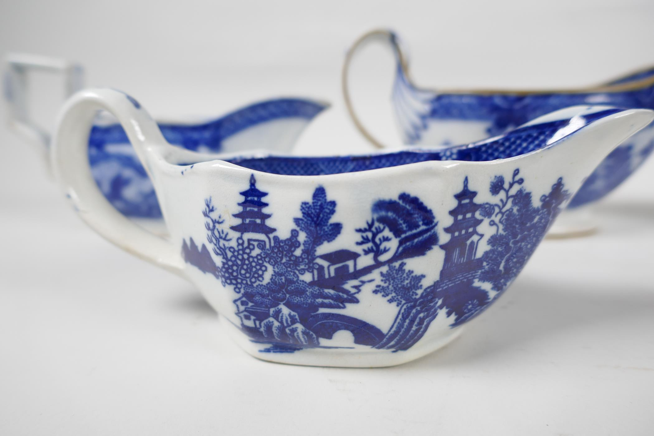 Five late C18th/early C19th English blue and white pottery sauce boats to include Boy on a Buffalo - Image 4 of 9