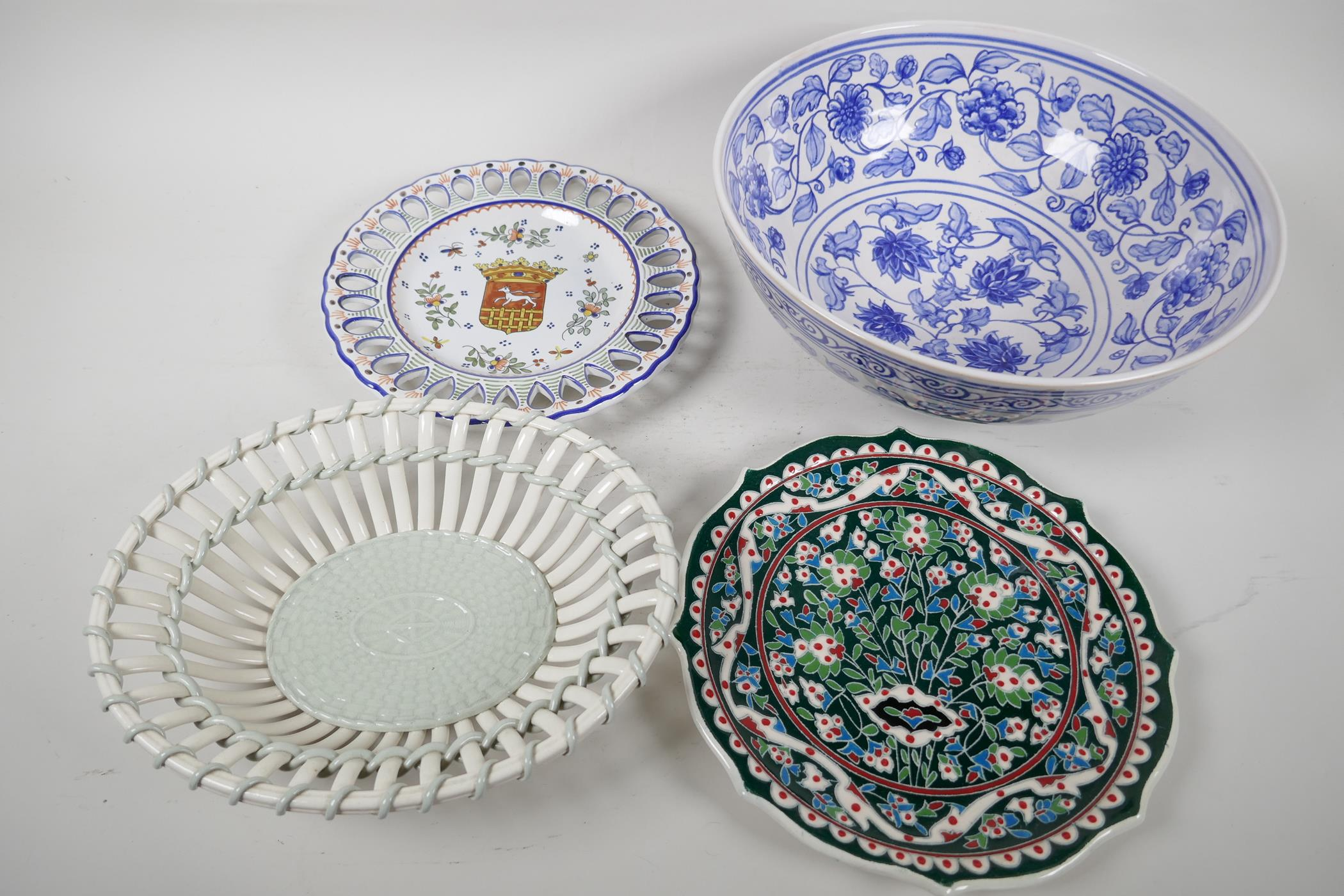 """A blue and white pottery mixing bowl, 11"""" diameter, together with a Wedgwood open basket work bowl"""