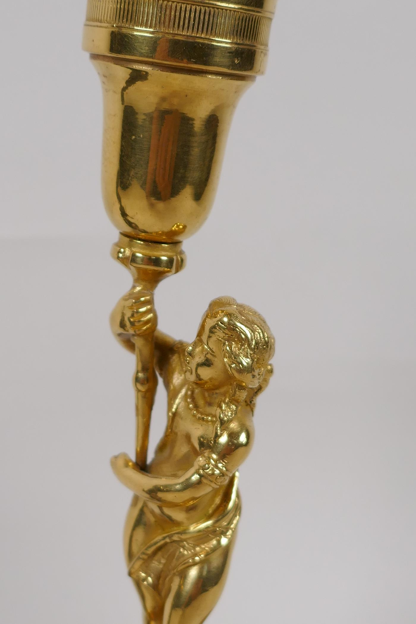 """A small bronze figure of a Roman soldier after the classic, 6"""" high, a brass figural candlestick and - Image 2 of 4"""