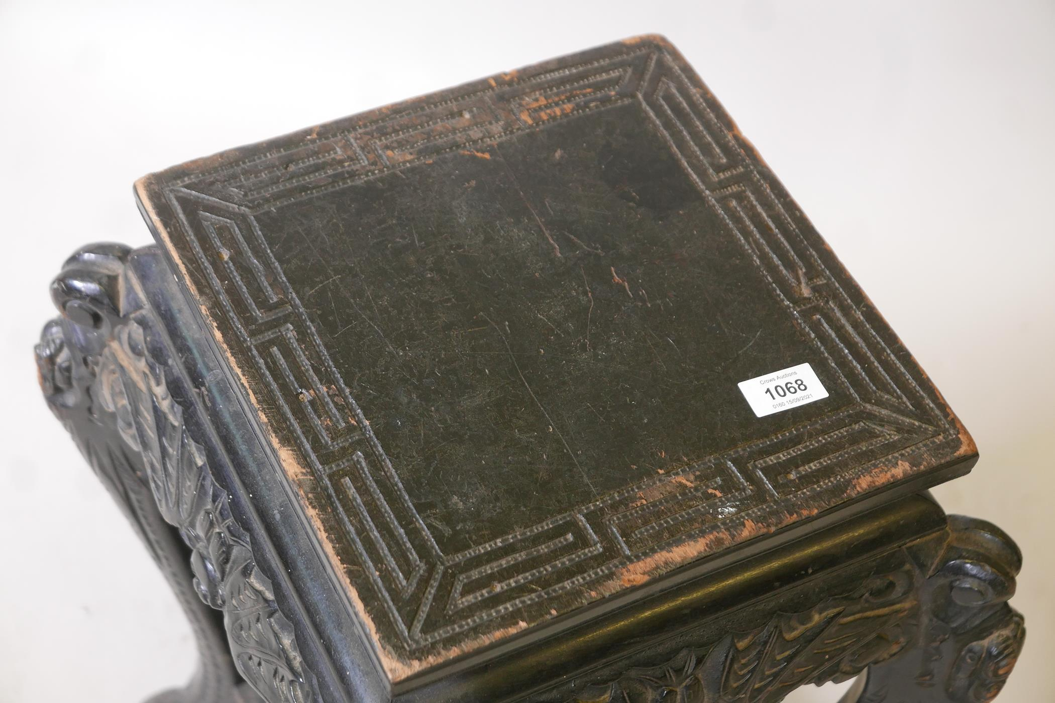 A Chinese two tier ebonised wood stand, with carved bat frieze, raised on scrolled shaped - Image 3 of 3