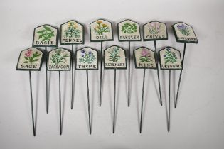 """A set of twelve painted cast iron herb markers, 3"""" x 2½"""""""