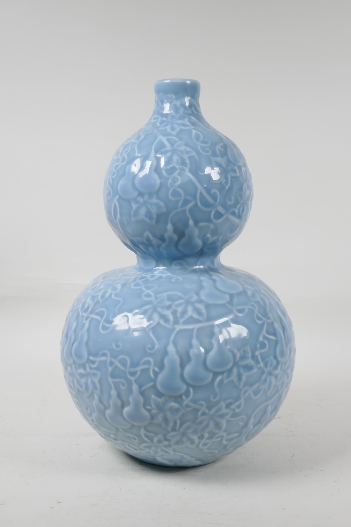 A Chinese blue glazed porcelain double gourd vase, with all over raised gourd vine decoration, - Image 3 of 4