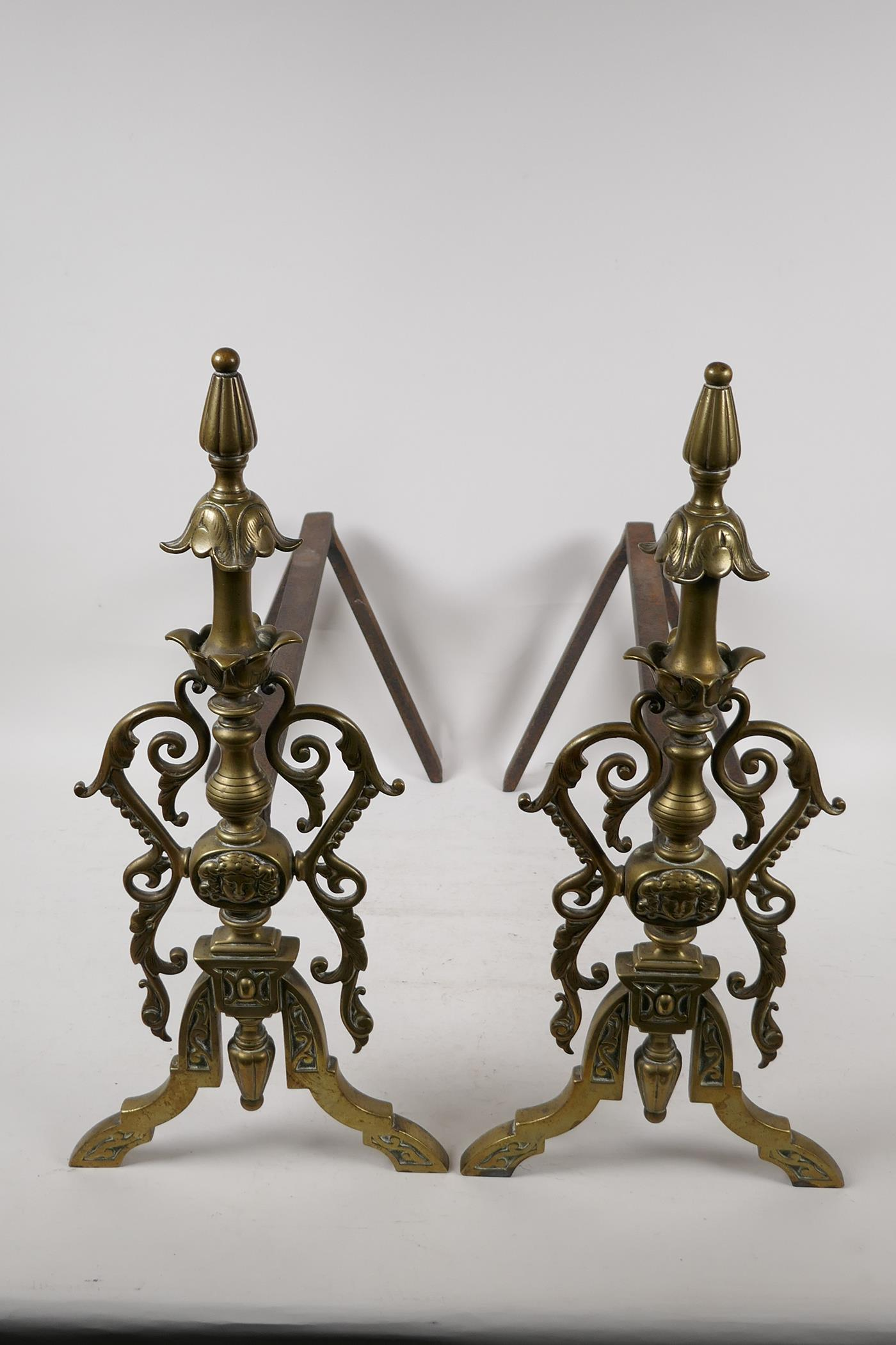 """A pair of C19th French cast brass and iron fire dogs, 16½"""" high, 16"""" long"""