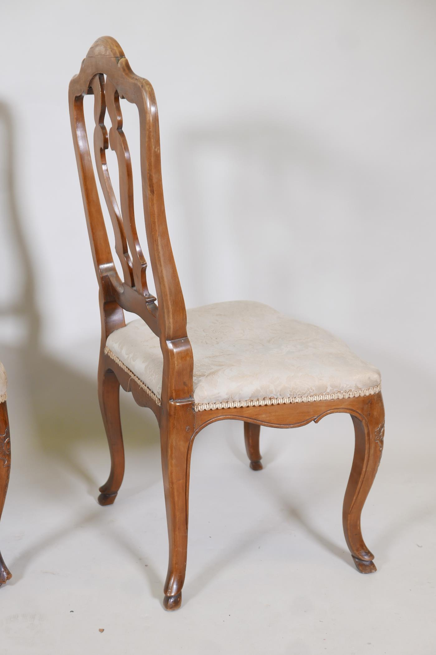 A pair of C18th French walnut pierced splat back side chairs with finely carved decoration, raised - Image 6 of 7