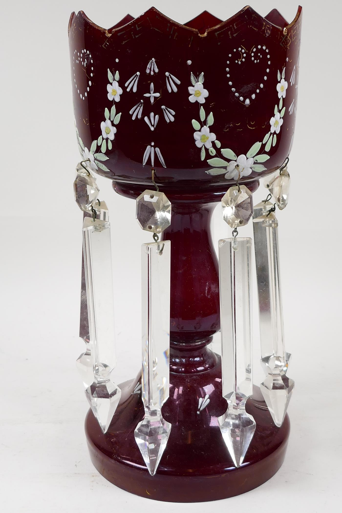 A Victorian ruby glass table lustre with crystal drops, and painted with flowers, one drop missing, - Image 2 of 3